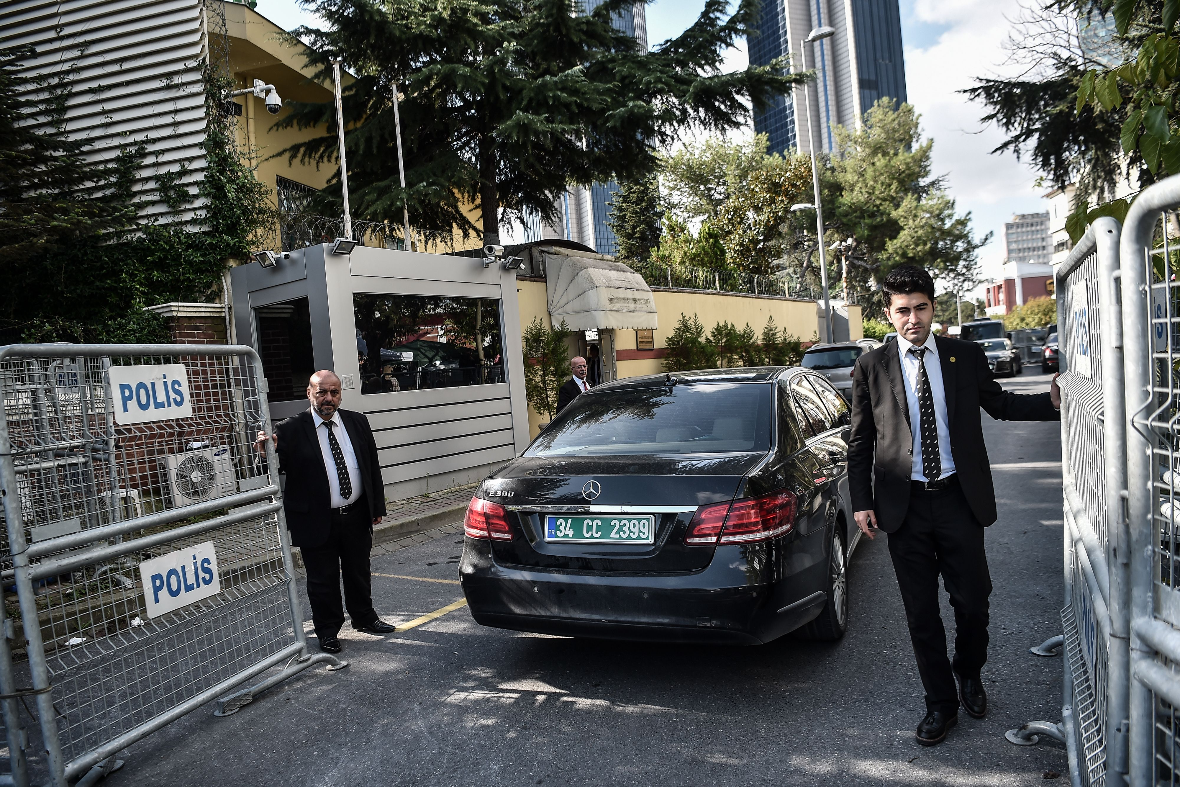 Security staff of the Saudi Arabian consulate in Istanbul open police barriers as a Saudi diplomatic vehicle arrives on October 16, 2018, following the departure of Turkish officials investigating the alleged murder of dissident journalist Jamal Khashoggi there. (Ozan Kose/AFP/Getty Images)