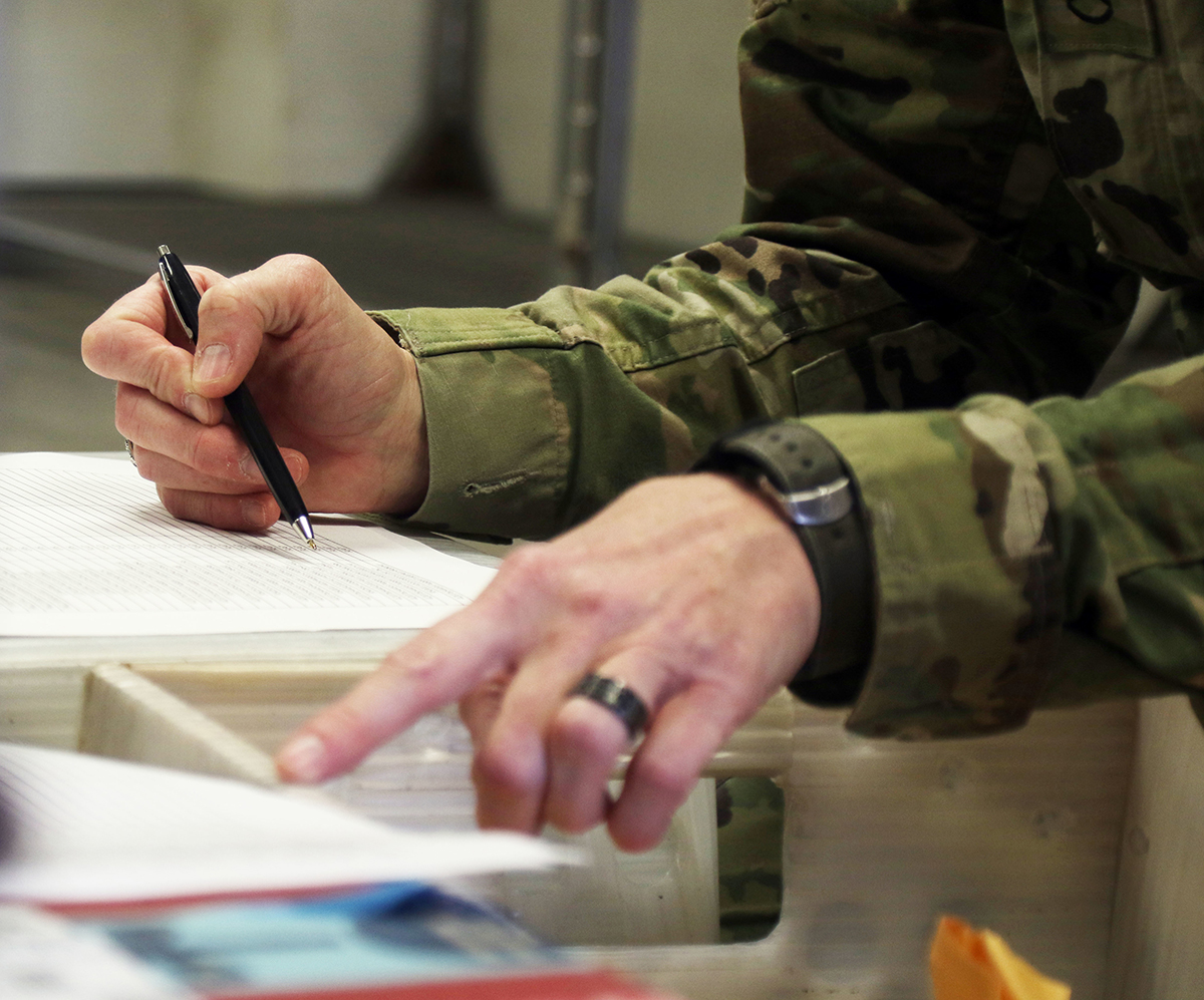 A soldier verifies serial numbers during mail pickup Dec. 4, 2018, at Fort Hood, Texas. (Sgt. Connie Jones/National Guard)