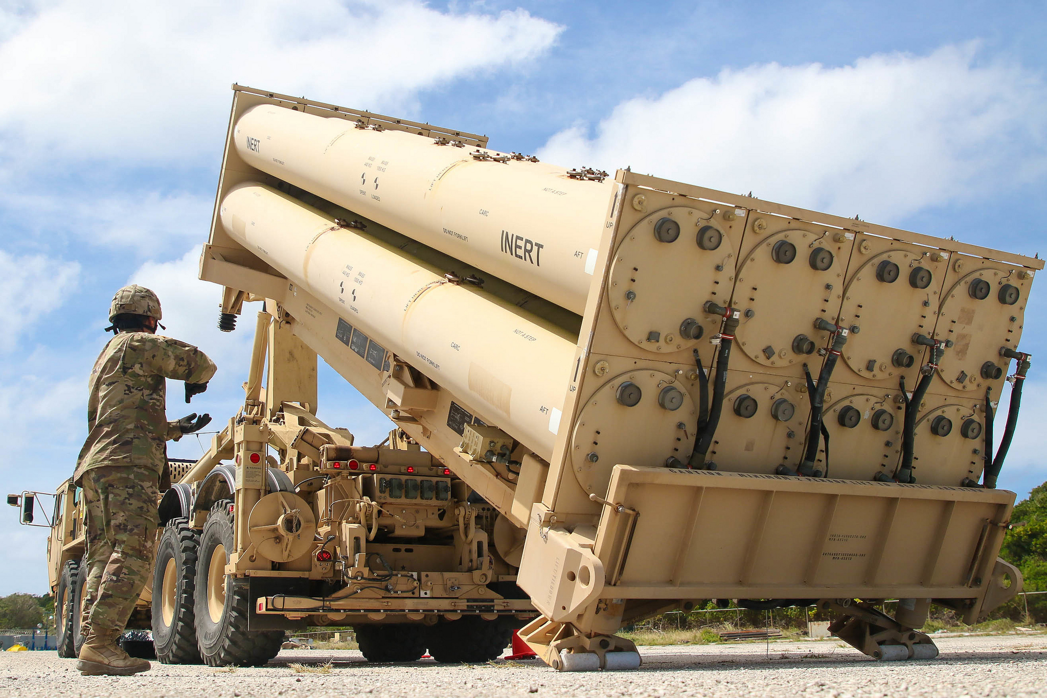 Cpl. Rogelio Argueta gives commands Feb. 6, 2019, during a practice missile reload and unload drills on a Terminal High Altitude Area Defense (THAAD) system trainer at Andersen Air Force Base, Guam. (Capt. Adan Cazarez/Army)