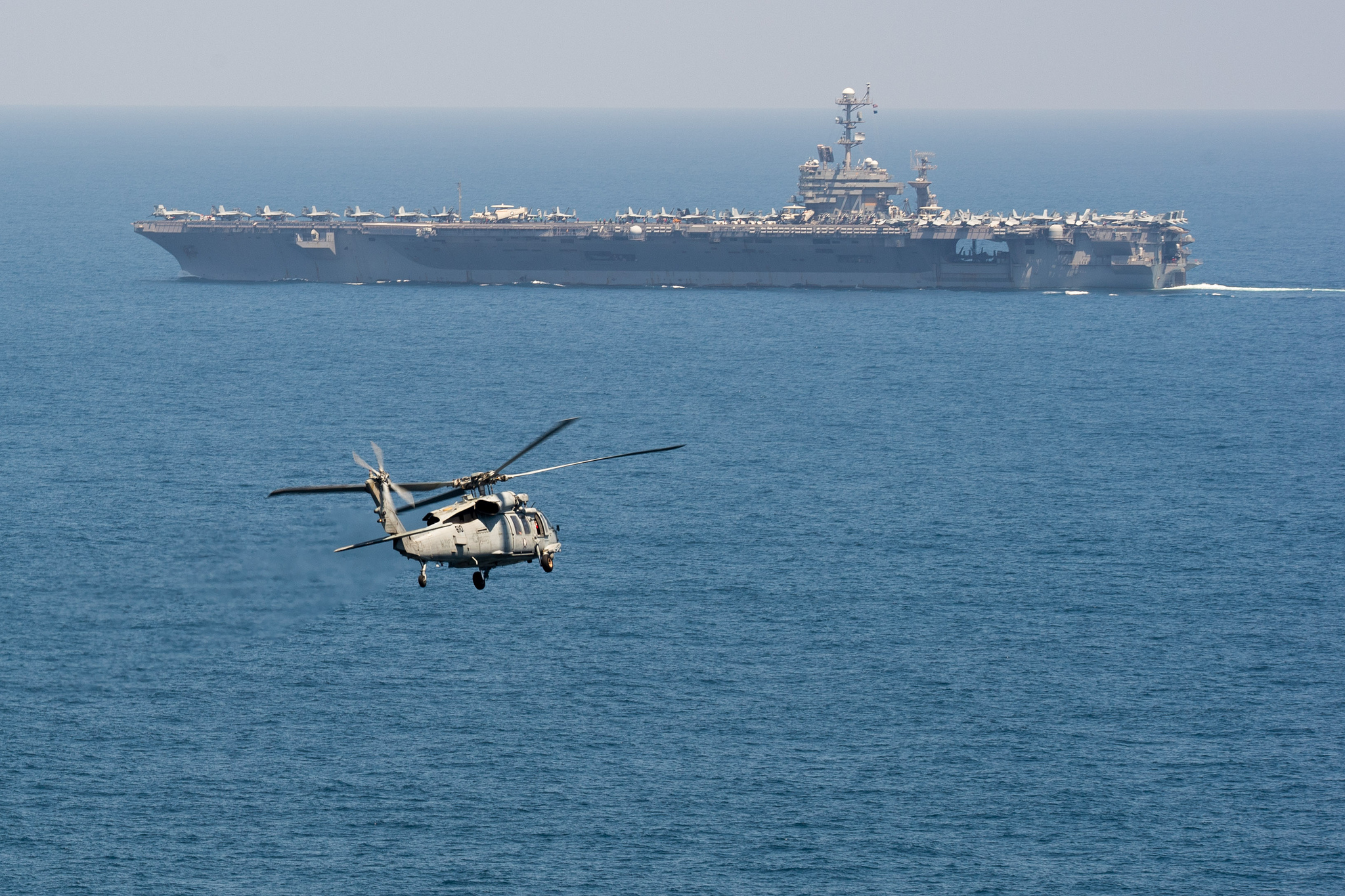 An MH-60S Sea Hawk helicopter flies toward the aircraft carrier USS John C. Stennis (CVN 74) on March 16, 2019, in the Indian Ocean. (Mass Communication Specialist 3rd Class Grant G. Grady/Navy)