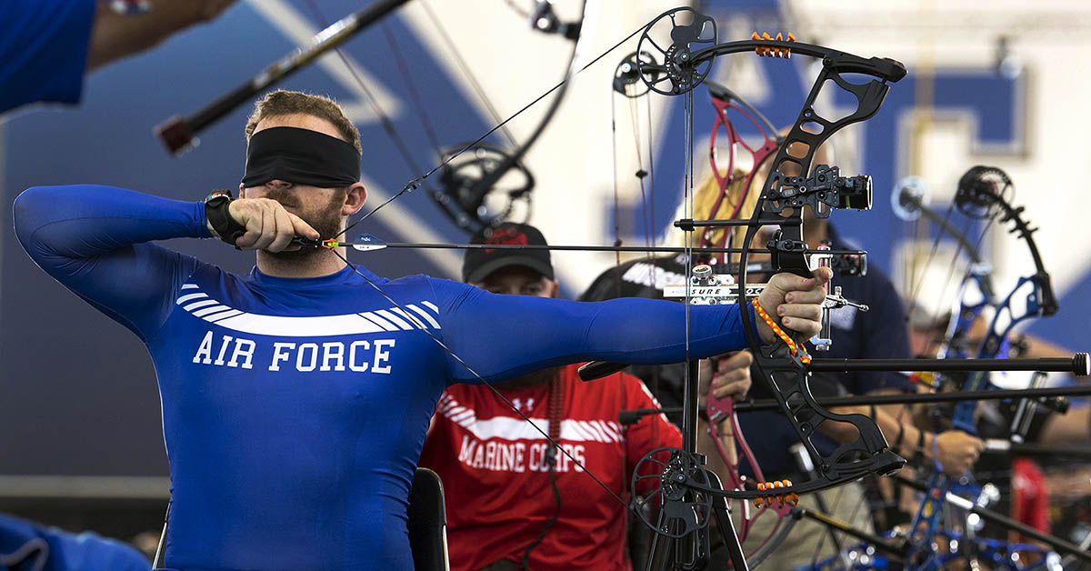 Team Air Force veteran Sr. Airman Brett Campfield competes in the visually impaired category for archery during the 2018 DoD Warrior Games at the Air Force Academy in Colorado Springs, Colo. June 7, 2018. (EJ Hersom/DoD)