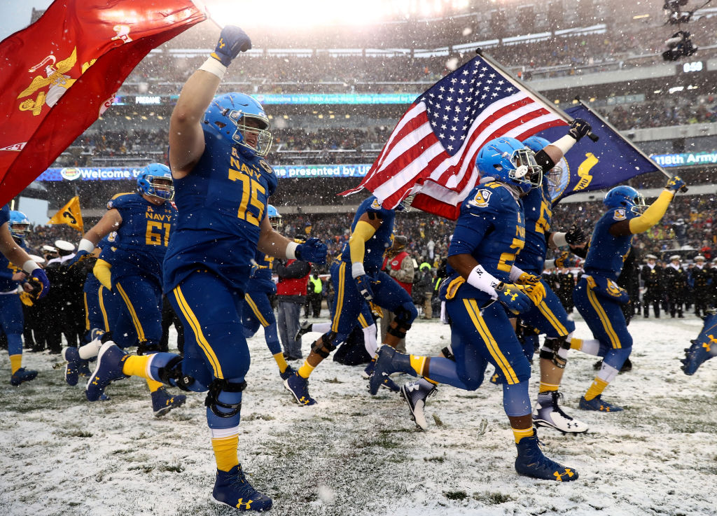 The Navy Midshipmen take the field before Saturday's Army-Navy game in Philadelphia. (Elsa/Getty Images)