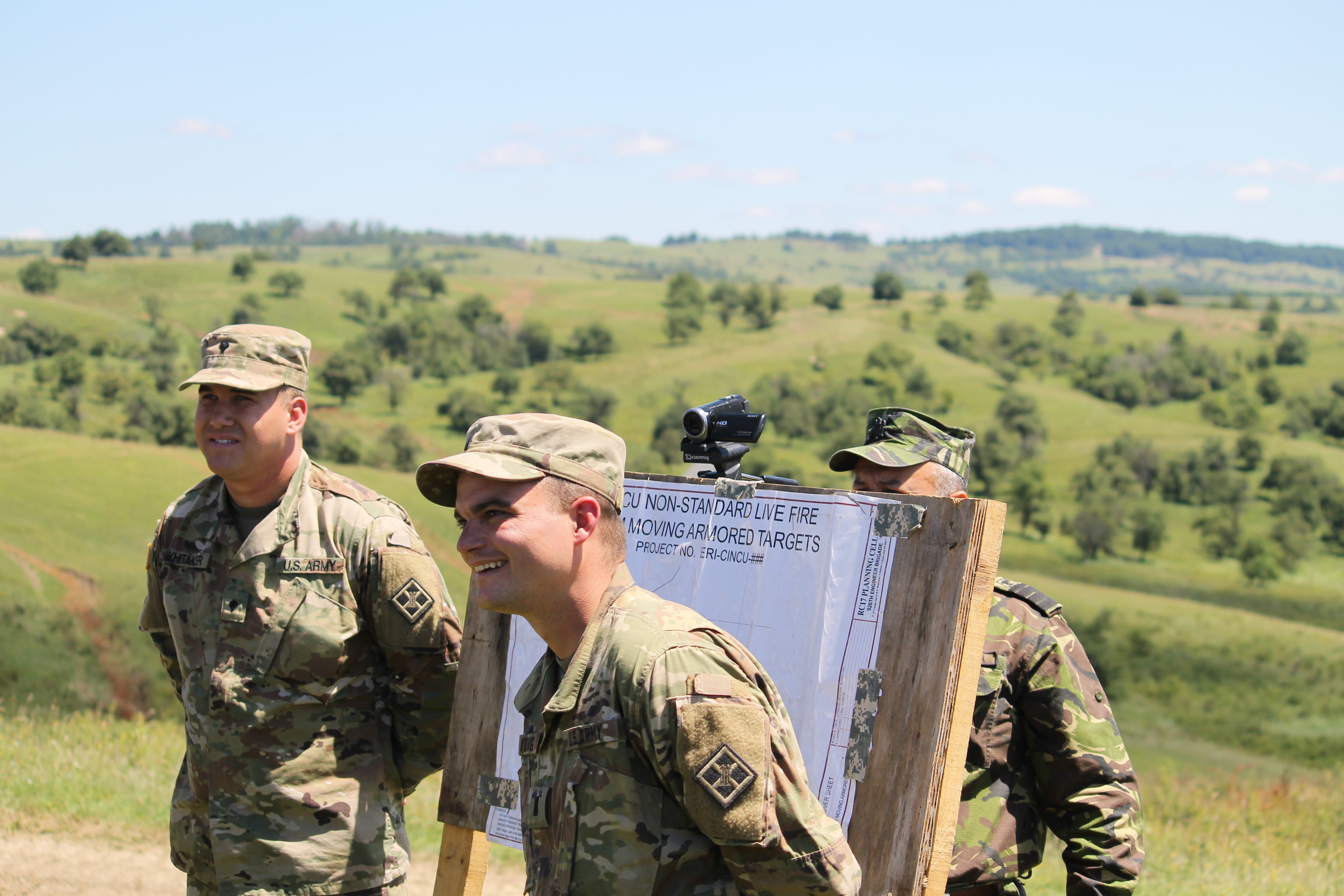 A group of U.S reservists from the 926th Engineering Brigade brief distinguished visitors, including Lt. Gen. Ben Hodges and U.S. ambassador to Romania Hans Klemm, on July 14 overlooking the nonstandard live fire training range. (Jen Judson/Staff)