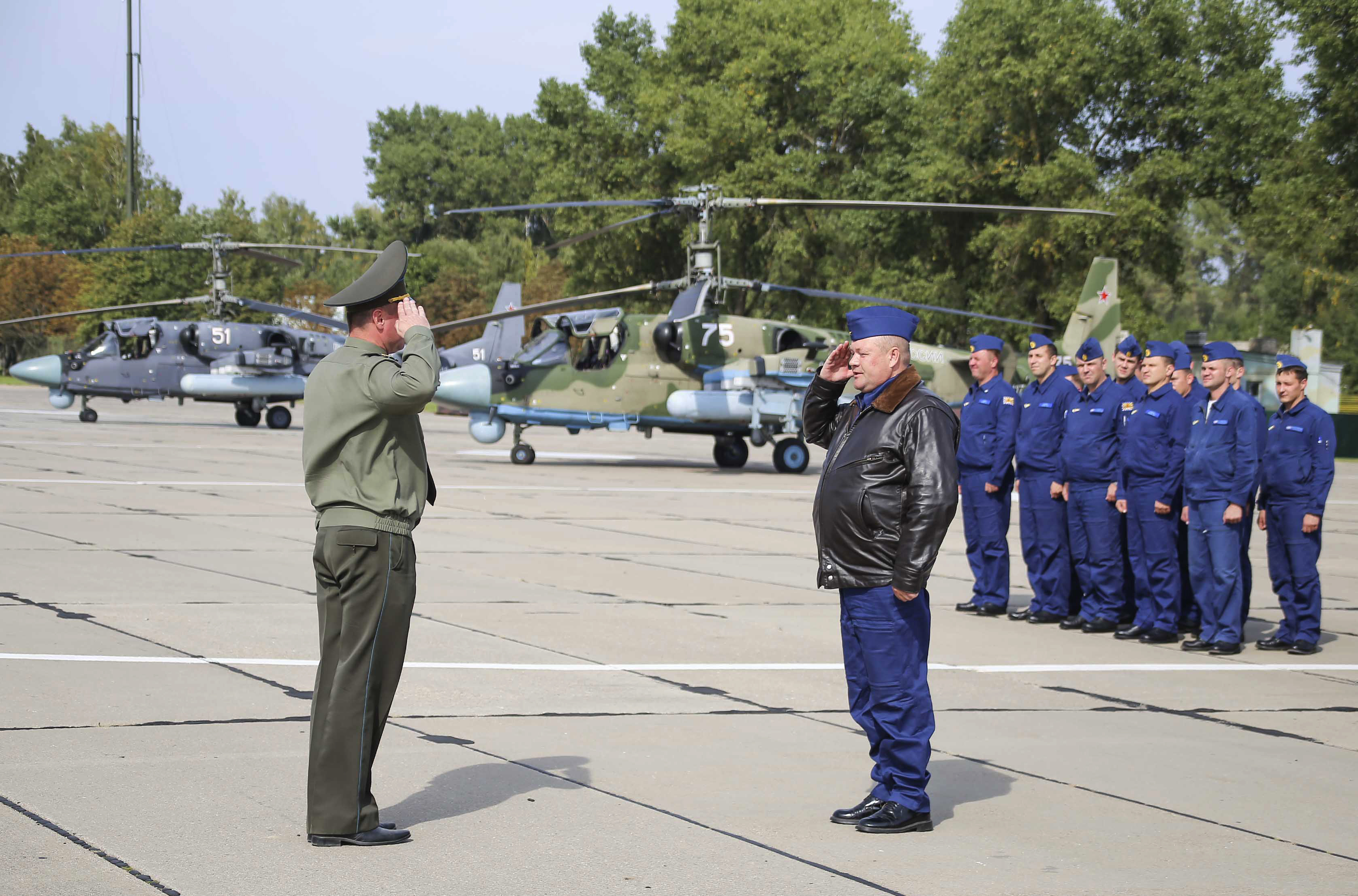 Russian military pilots, right, report upon arrival at an air base in Belarus prior to the start of Zapad 2017. (Vayar Military Agency photo via AP)