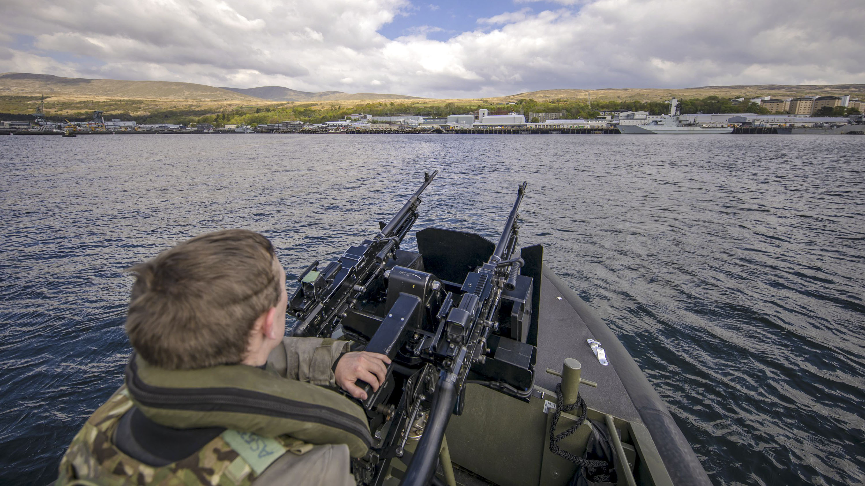 A Royal Marine patrols the waters at HMNB Clyde, which is the home of the UK's Trident nuclear deterrent, Faslane, west of Glasgow, Scotland on April 29, 2019. - A tour of the submarine was arranged to mark fifty years of the continuous, at sea nuclear deterrent. (JAMES GLOSSOP/AFP/Getty Images)