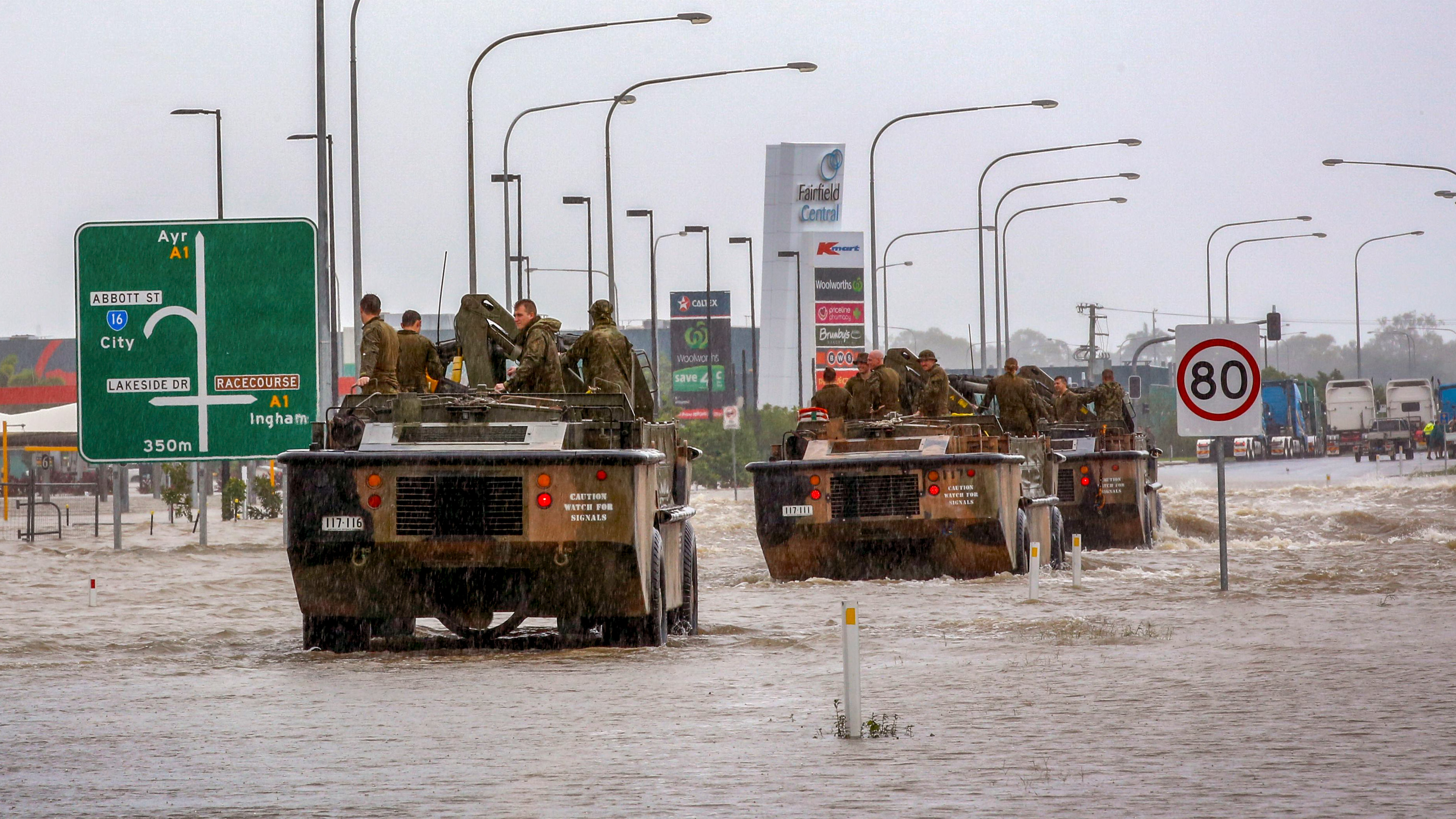 Australian Army vehicles enter Townsville to help evacuate flood-affected people on February 4, 2019, as the recent downpour in Australia's tropical north has seen some areas get a year's worth of rainfall in a week. - Australia's military has been deployed to tackle devastating
