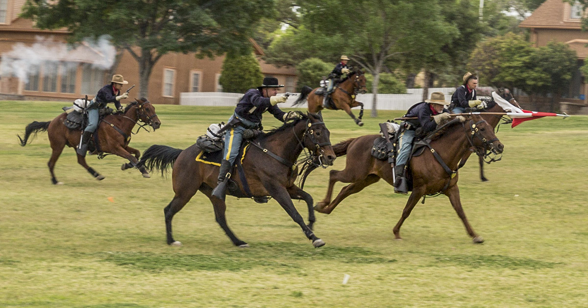 "B Troop, 4th Cavalry Regiment (Memorial) executes a ""Cavalry Charge"" in honor of the outgoing commander for the 304th Military Intelligence Battalion, Lt. Col. Paul Oh, during a change of command ceremony at Fort Huachuca, in Arizona on June 15. (Randall Baucom/Army)"