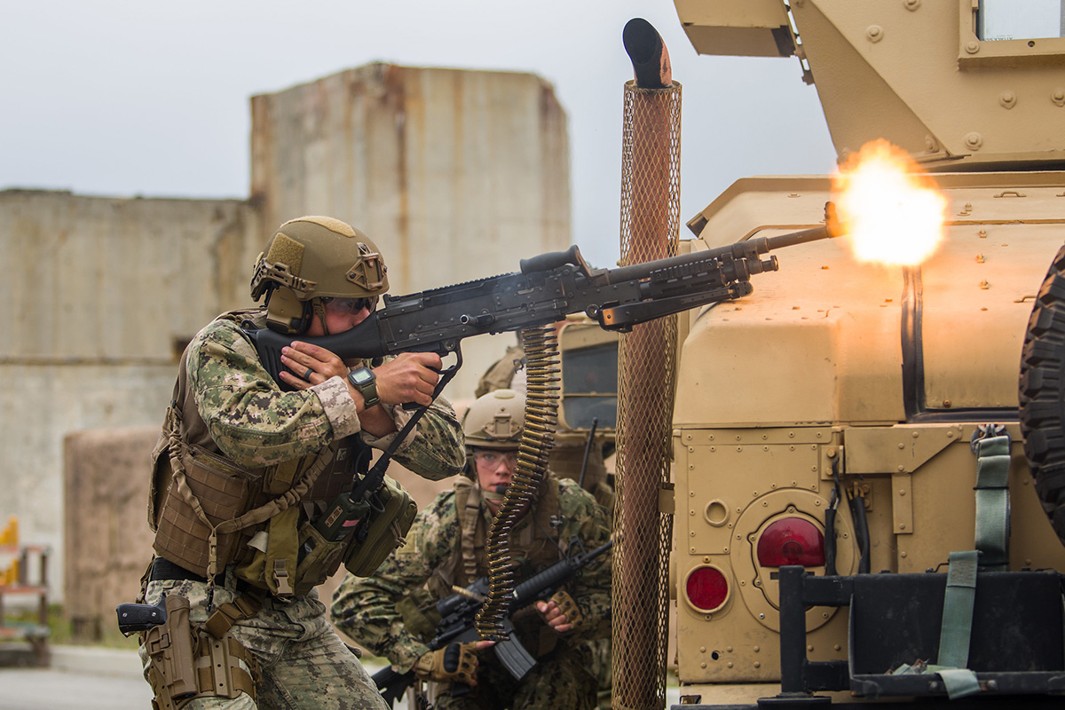 Engineman 2nd Class Christian McCain engages opposing forces while dismounted with an M240 machine gun on June 14, 2019, as the Coastal Riverine Squadron 1 convoy section is assessed at Naval Air Station Point Mugu, Calif. (Hospital Corpsman 1st Class Kenji Shiroma/Navy)