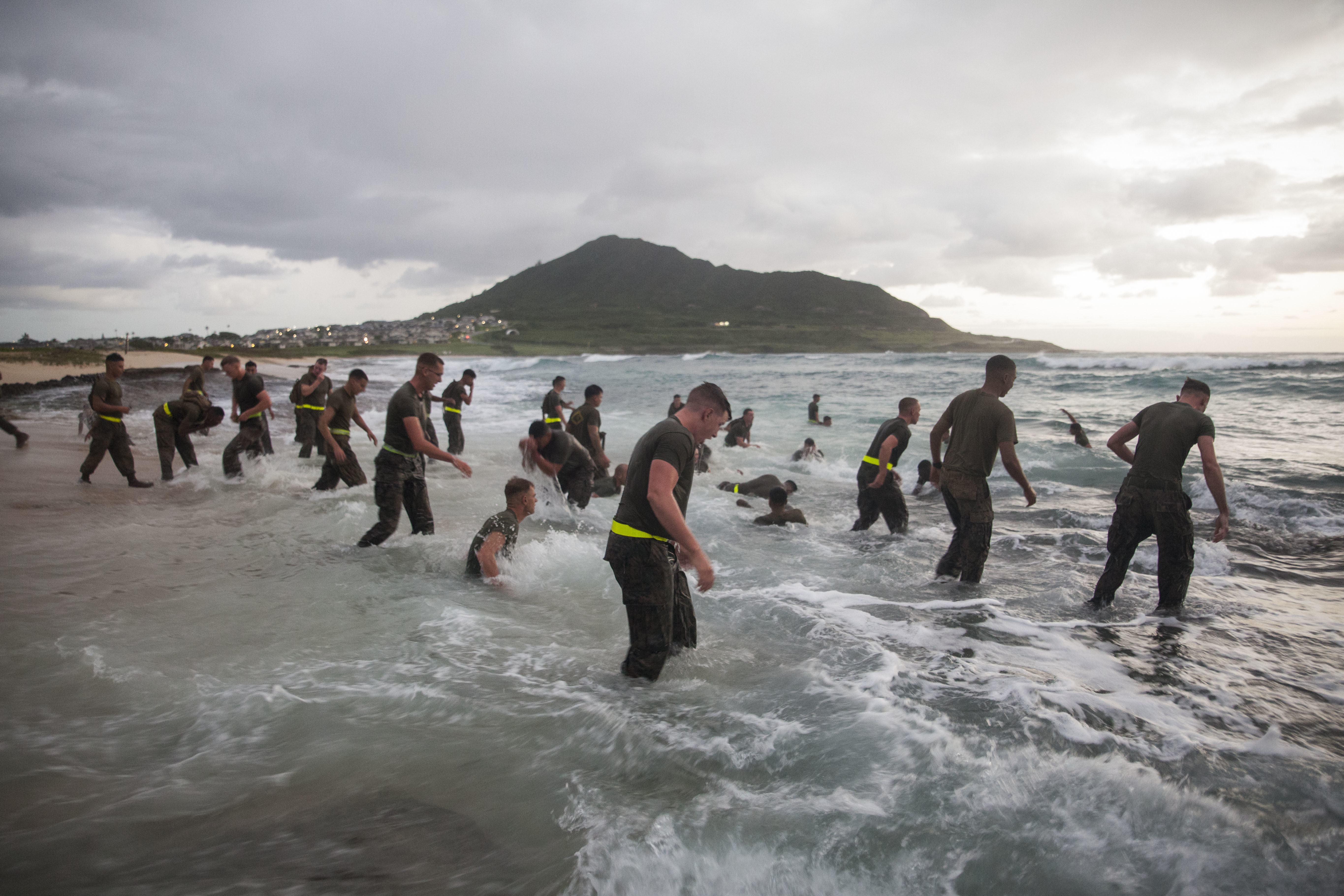 U.S. Marines with Combat Assault Company (CAC), 3rd Marine Regiment, wash off sand in the Pacific ocean after conducting ground fighting in conjunction with the 74th anniversary of the Battle of Tarawa, Fort Hase Beach, Marine Corps Base Hawaii (MCBH). (Cpl. Jesus Sepulveda Torres/Marine Corps)