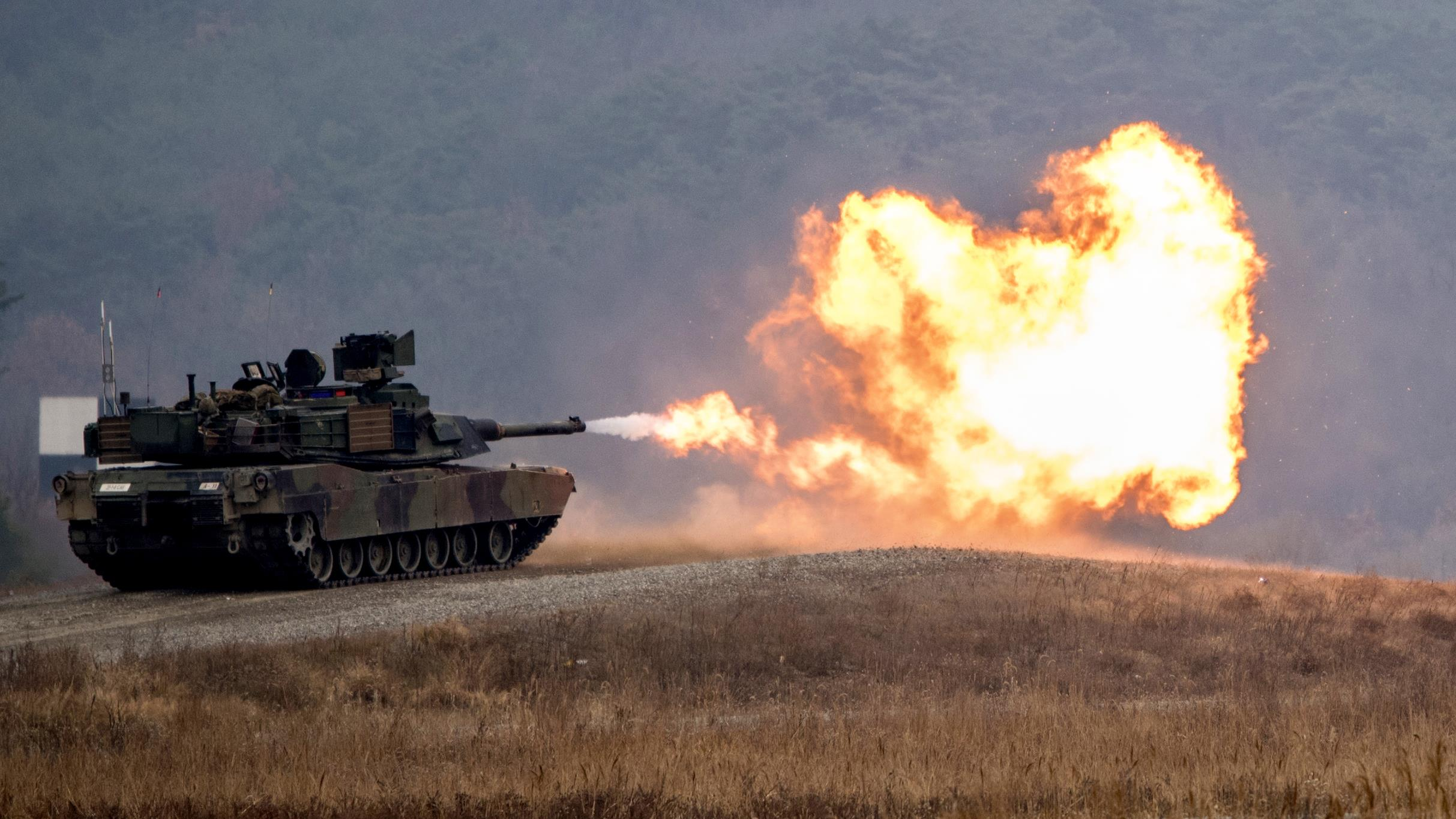 Soldiers fire the main weapon of an M1A2 Abrams tank during a gunnery qualification event at the Rodriguez live fire complex in South Korea, Nov. 28, 2017. The soldiers are assigned to the 1st Battalion, 8th Cavalry Regiment. Army photo by Sgt. Patrick Eakin