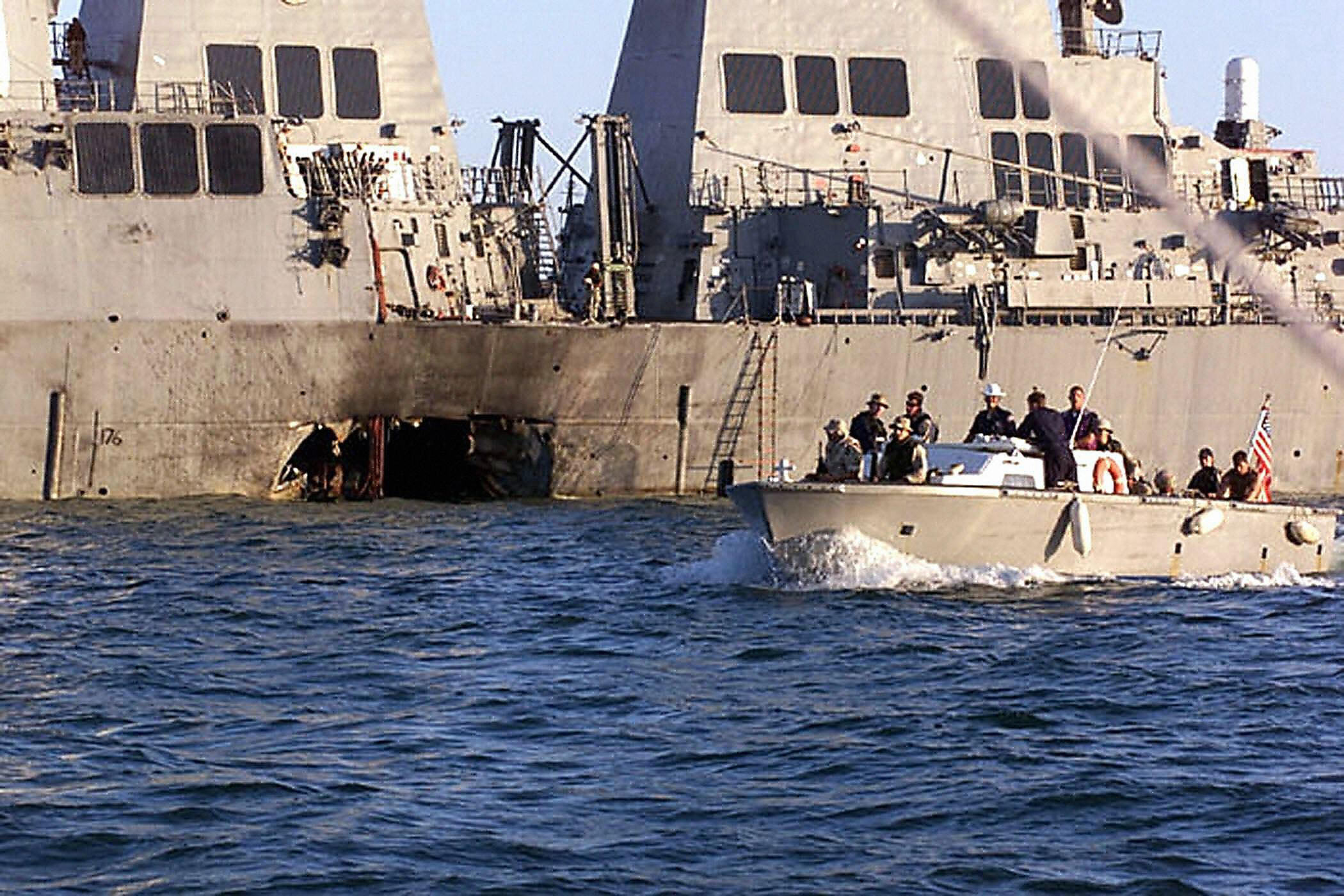 This US Navy file photo shows US Navy and Marine Corps security personnel patrolling past the damaged US Navy destroyer USS Cole 18 October 2000 following the 12 October 2000 terrorist bombing attack on the ship in Aden, Yemen. Abdel Rahim al-Nashiri and Jamal Mohammed al-Bedawi, the two Al-Qaeda suspects convicted for the bombing, were sentenced to death September 29, 2004 by a Yemeni court. Four other suspects were given ten years in prison. (LYLE G. BECKER/AFP/Getty Images)