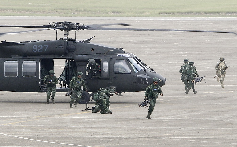 A Taiwanese special forces unit exits a UH-60 Black Hawk helicopter during the annual Han Kuang exercises at an air base in Taichung County, Taiwan. (Chiang Ying-ying/AP)
