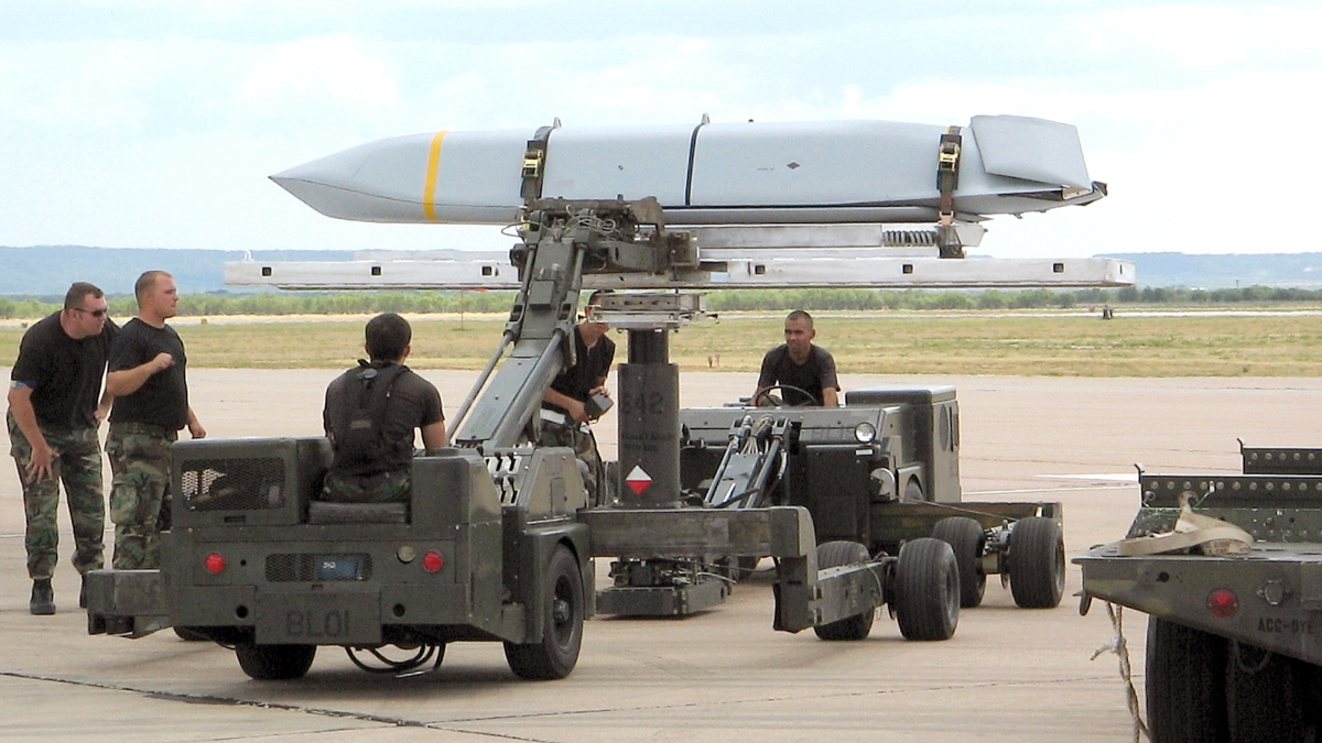 Airmen here prepare a Joint Air-to-Surface Standoff Missile to be loaded onto a B-1B Lancer. The JASSM, or AGM-158A, is an air-to-surface, single warhead self-propelled missile. (Air Force)
