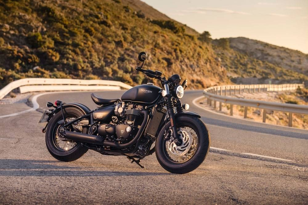 The Bobber Black's timeless style naturally highlighted against a canvas adorned with the Spanish hillside. (Triumph Motorcycles)
