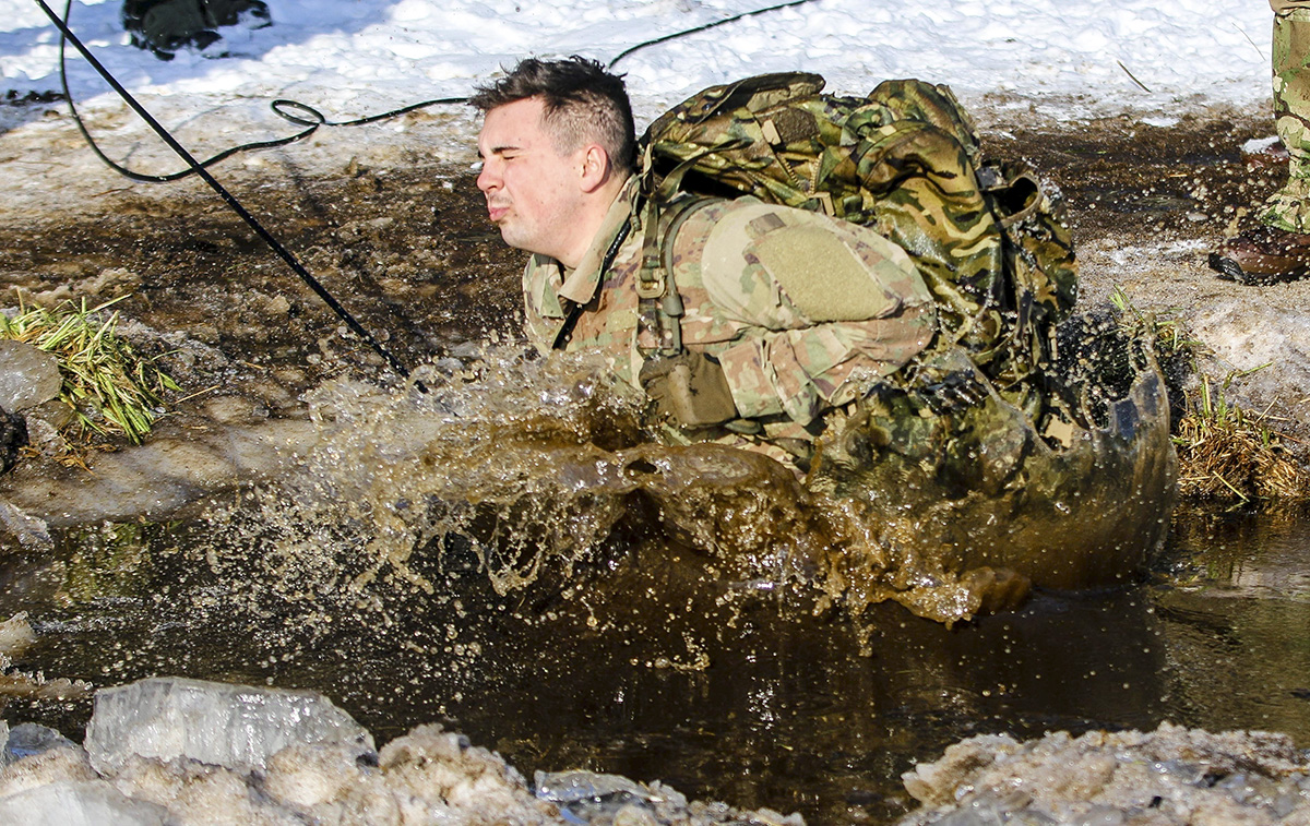 Pfc. Ryan Oliver, a Denver, Colorado native and a wheeled vehicle mechanic with the 82nd Brigade Engineer Battalion, 2nd Armored Brigade Combat Team, 1st Infantry Division, jumps into a lake during cold-water immersion training with the U.K. 1st Royal Welsh Battalion in Tapa, Estonia on March 7, 2018 as part of an rapid response readiness exercise in support of Atlantic Resolve. The 2nd ABCT demonstrates readiness by training and exercising it's ability to quickly mass, mobilize and perform it's warfighting functions with NATO allies and by building and displaying maximum proficiency in its capabilities. (Spc. Hubert D. Delany III/Army)