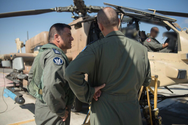 Maj. Gen Amikam Norkin, Israel Air Force commander, oversees the return of the first Apaches to operational duty after they were grounded for nearly three months. (Courtesy of Israel Defense Forces)