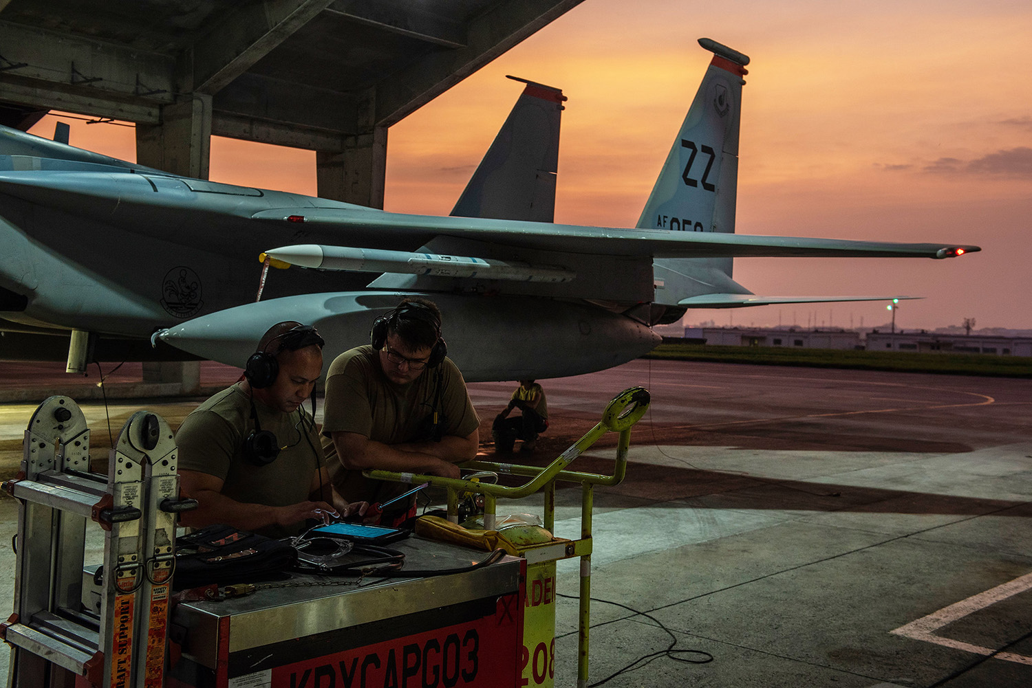 Crew chiefs assigned to the 18th Aircraft Maintenance Squadron discuss the preparation requirements for a 67th Fighter Squadron F-15C Eagle before a mission at Kadena Air Base, Japan, Sept. 16, 2019. (Tech. Sgt. Matthew B. Fredericks/Air Force)