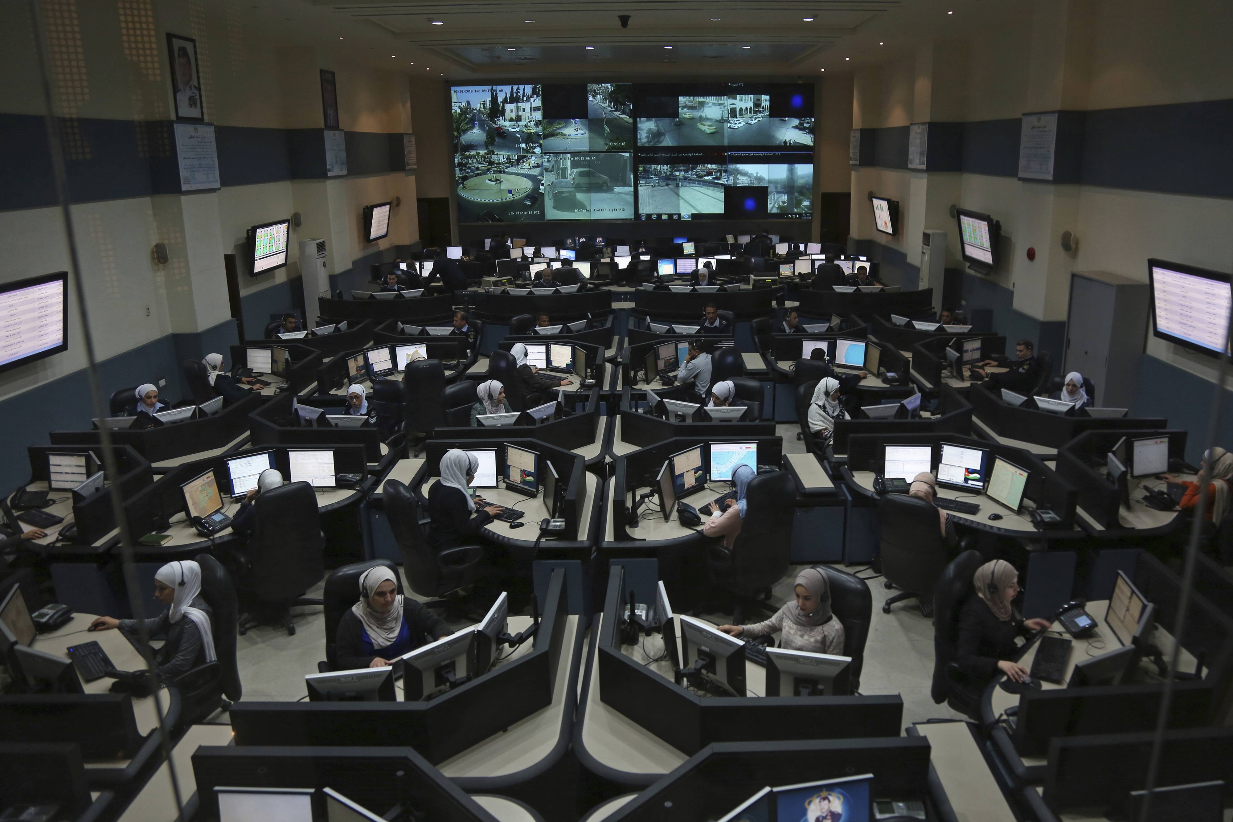 Call-takers and dispatchers are seen at Jordan's 911 emergency call center in the capital of Amman, which receives thousands of calls a day. (Raad Adayleh/AP)