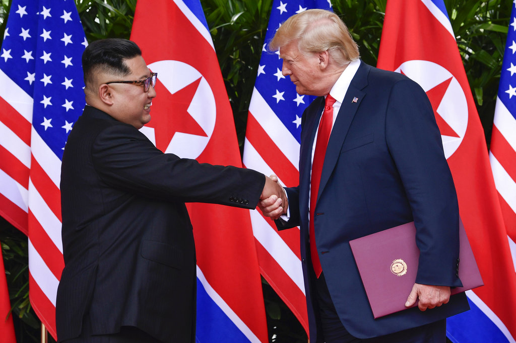 North Korea leader Kim Jong Un, left, and U.S. President Donald Trump conclude their meetings in Singapore in June 2018. The White House announced Friday, Jan. 18 that a second summit is planned for February. (Susan Walsh/Pool photo via AP)