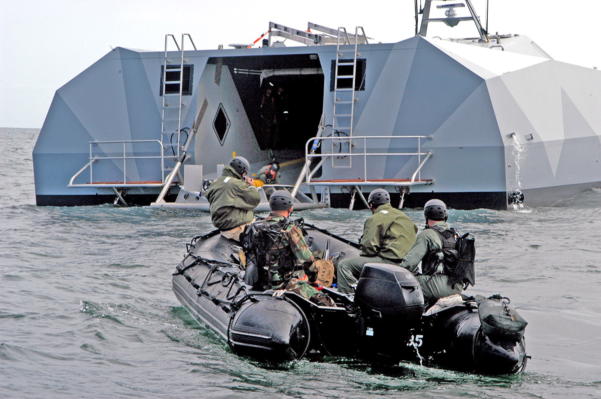 San Diego (May 6, 2006) - Sailors assigned to Naval Special Clearance Team One (NSCT-1) prepare to enter the well deck aboard experimental boat ship Stiletto off the coast of San Diego. Members of NSCT-1 are participating in Exercise Howler. Stiletto is being tested for its usefulness in littoral combat warfare and interoperable environments. (photo by PHAN Damien Horvath/Navy)