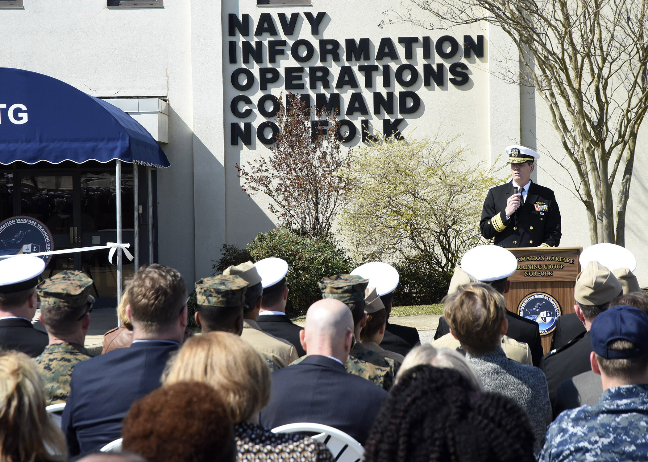 Commander, Naval Information Forces (NAVIFOR) Vice Adm. Matthew Kohler, speaks at the Information Warfare Training Group in Norfolk, Virginia, ribbon cutting ceremony. Naval Information Operations Command (NIOC) Norfolk disestablished to create IWTG Norfolk. (U. S. Navy photo by Chief Mass Communication Specialist Rafael Martie / Released)