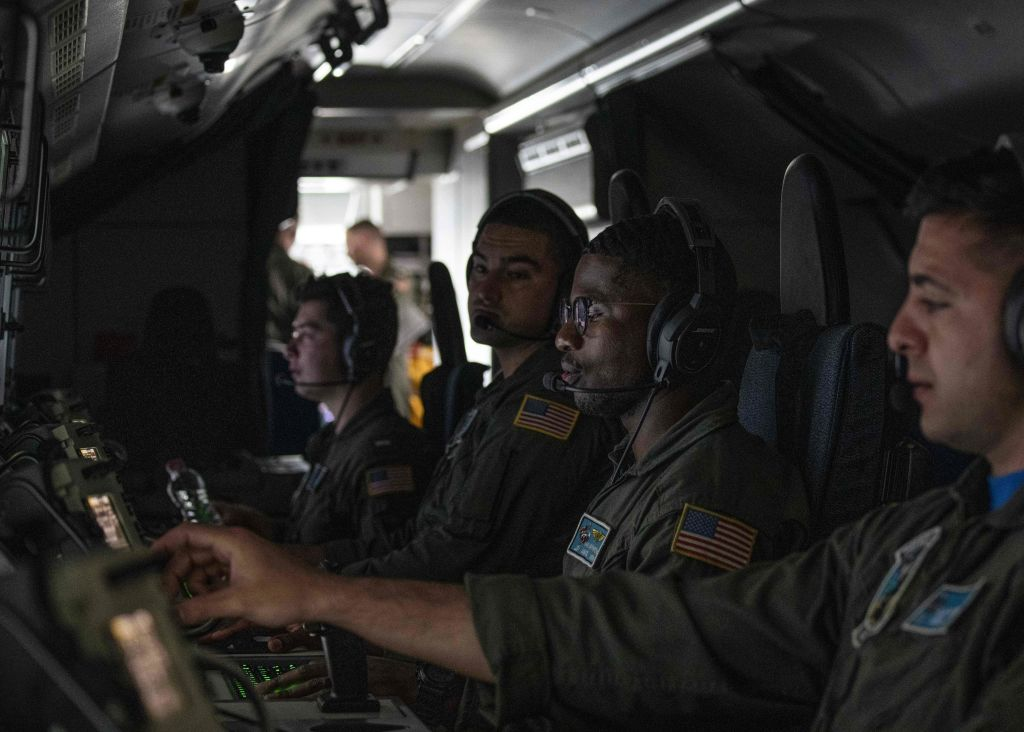 US Navy aircrew members operate the tactical systems onboard the P-8A Poseidon maritime patrol and reconnaissance aircraft during the US and Association of Southeast Asian Nations (ASEAN) maritime exercise at the gulf of Thailand on September 5, 2019. MLADEN ANTONOV/AFP/Getty Images)