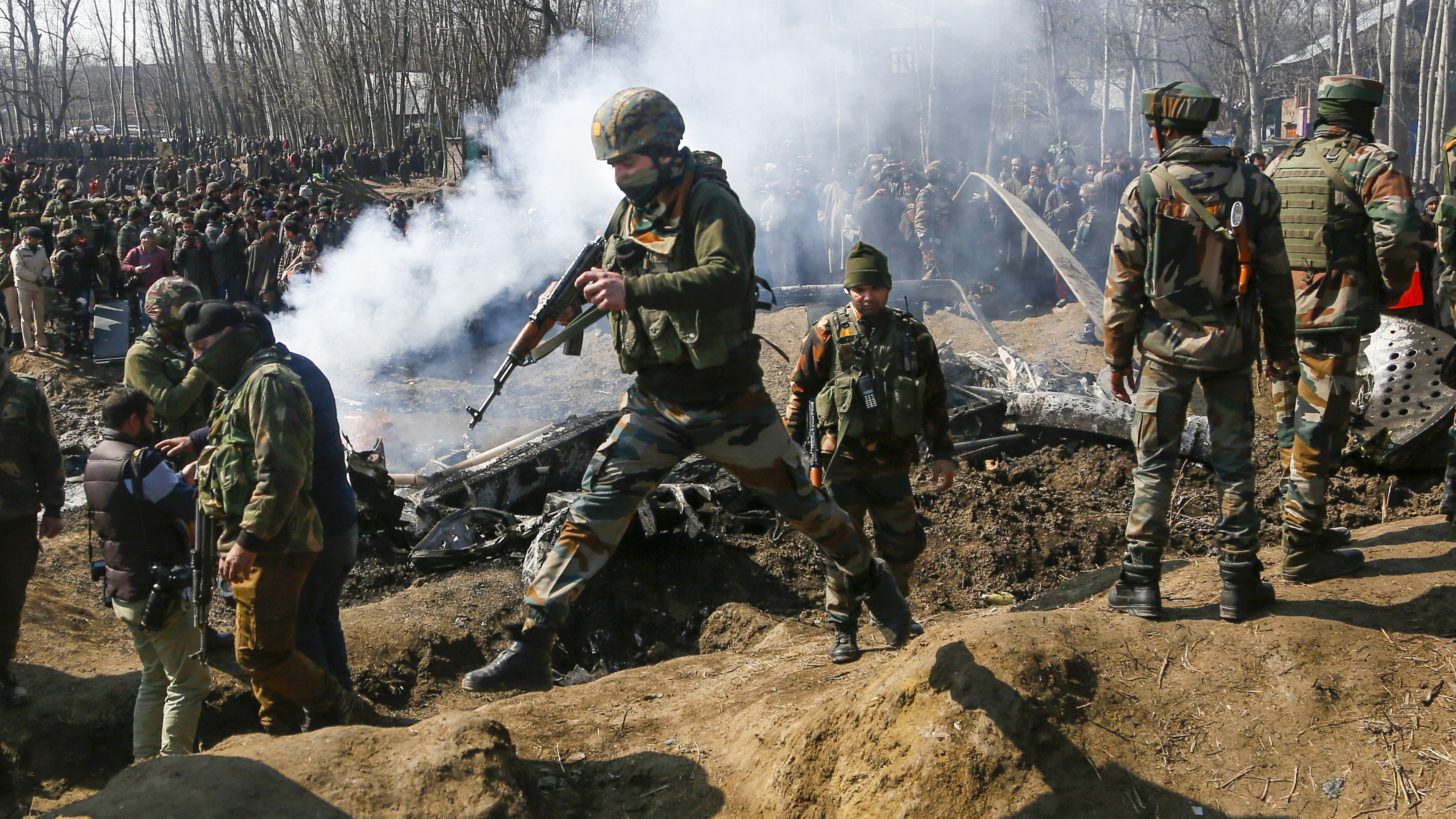 In this Wednesday, Feb.27, 2019 file photo, Indian army soldiers arrive at the wreckage of an Indian helicopter after it crashed killing several in the Budgam area, on the outskirts of Srinagar, Indian controlled Kashmir. This week's standoff between India and Pakistan is their latest in a long dispute over the divided Himalayan region of Kashmir, dating back to their independence in 1947. (AP Photo/Mukhtar Khan)