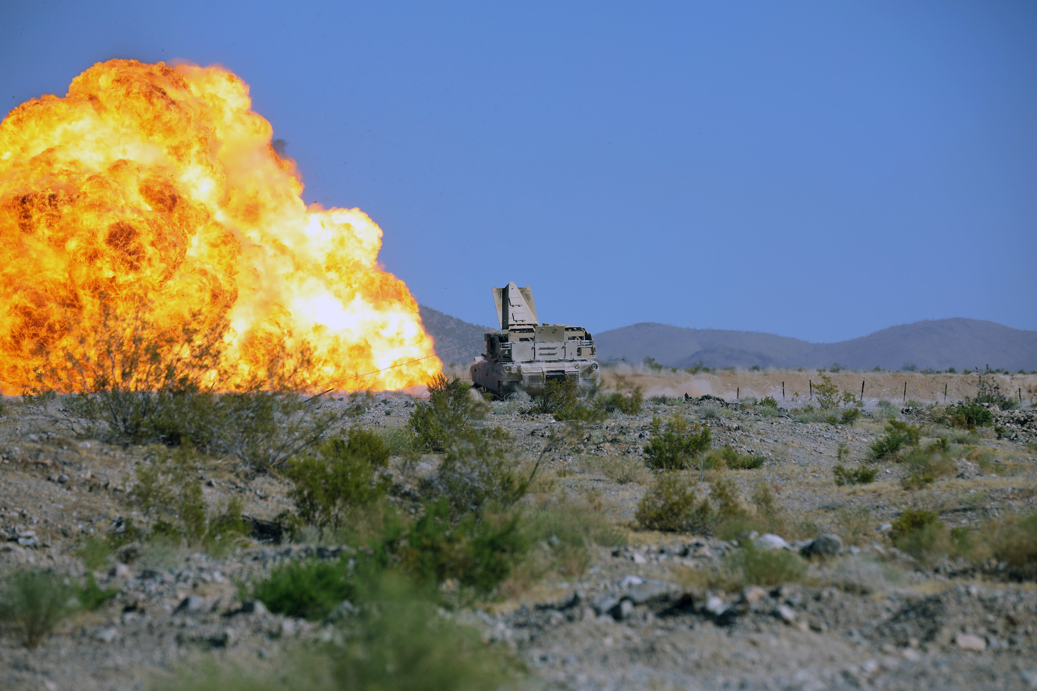 Soldiers detonate C4 from an Armored Breaching Vehicle while conducting a mine clearing line charge live-fire during their 19-09 rotation on July 17, 2019, at the National Training Center at Fort Irwin, Calif. (Staff Sgt. Leticia Samuels/Army National Guard)