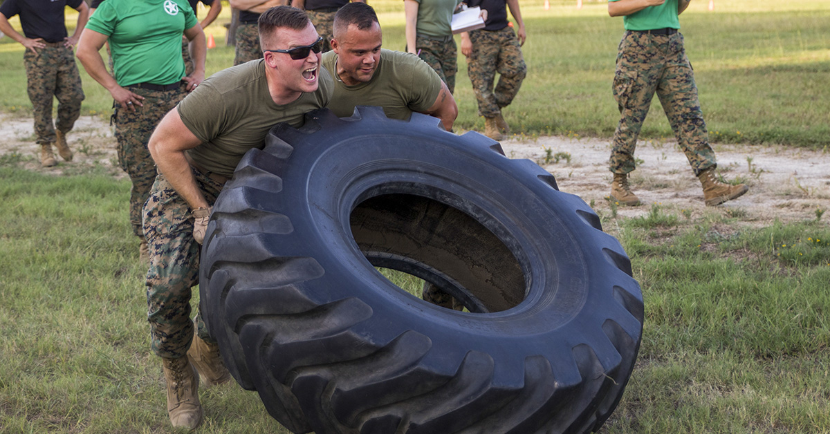 Marines do a series of tire flips in a timed event at Camp Maxey, Powderly, Texas as part of the Commander's Cup July 20, 2018. The Marines of Recruiting Sub-Station Longview were crowned as the champions of this year's competition. (Sgt. Sarah Luna/Marines)