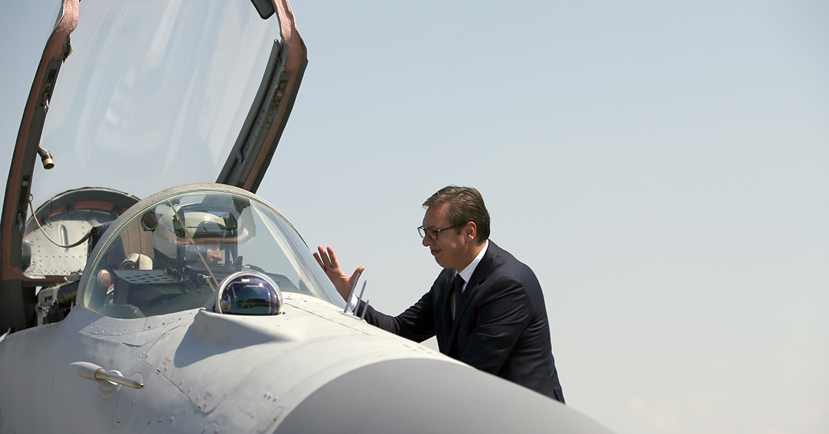 Serbian President Aleksandar Vucic speaks with a pilot of MiG-29 jet fighter on the tarmac at Batajnica, military airport near Belgrade, Serbia, Tuesday, Aug. 21, 2018. Serbia's air force has taken the delivery of two Russian MiG-29 fighter jets, part of an arms purchase that has the potential to heighten tensions in the Balkans and increase Moscow's influence in the region. (Darko Vojinovic/AP)