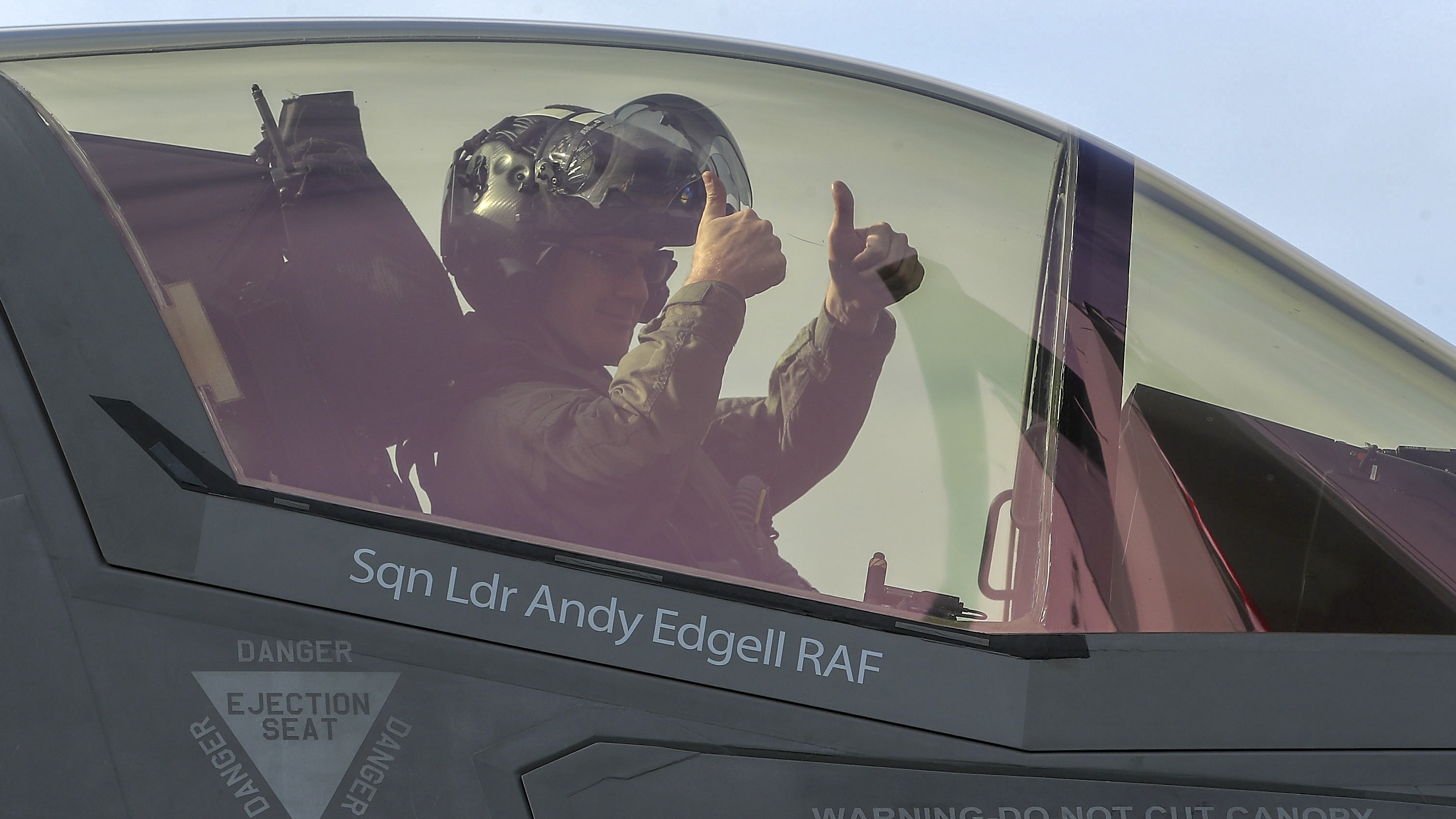 RAF Squadron Leader Andy Edgell sits in the cockpit of a new F35B Lightning fighter jet as he prepares to take off from the HMS Queen Elizabeth as it sails at sea in the Atlantic Ocean off the U.S. mid-Atlantic coast, on September 27, 2018. The carrier is currently participating in flight trials with two new F35-B's and eventually be able to embark up to 24 of the supersonic jets. (Photo by Mark Wilson/Getty Images)