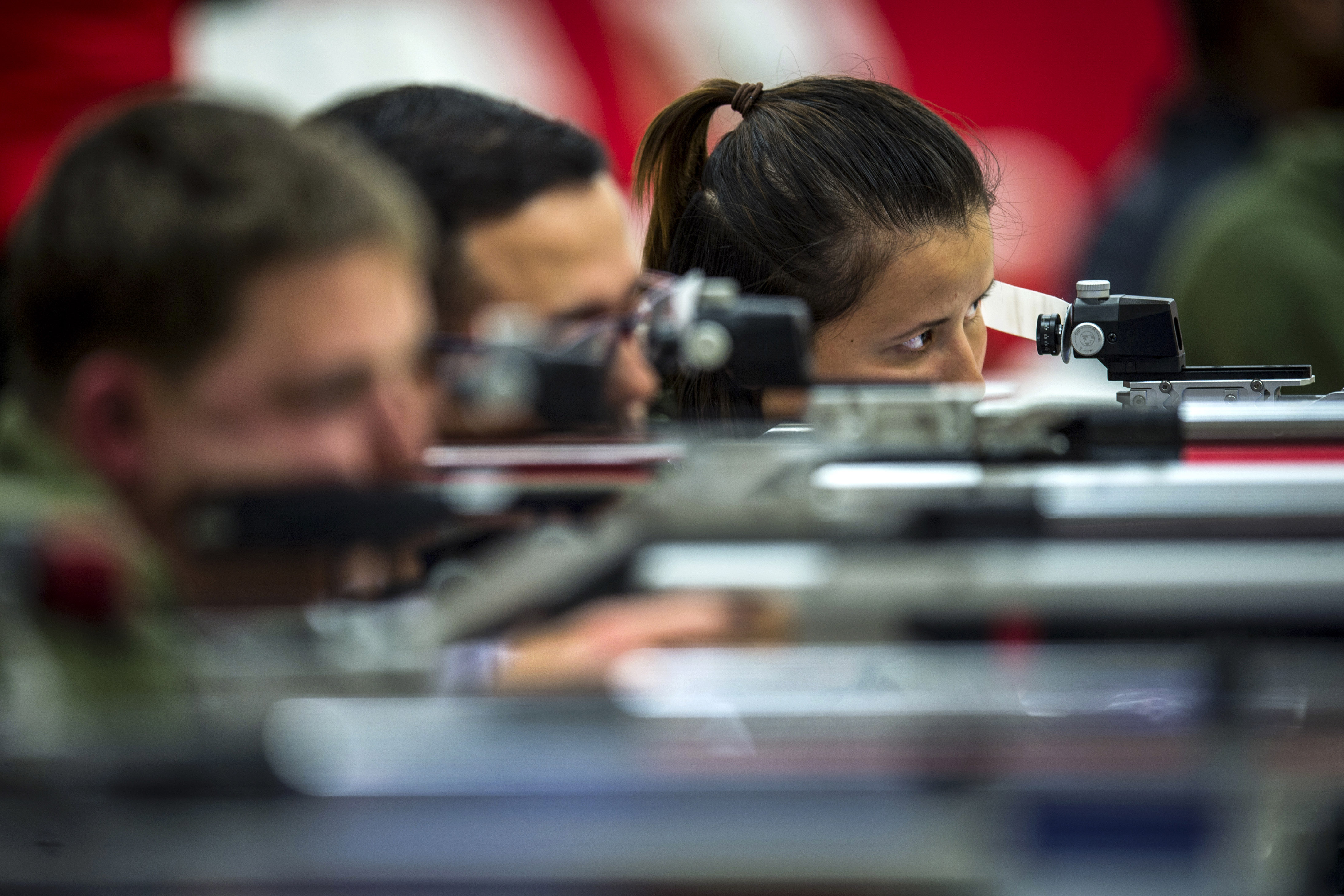 Marine Corps Lance Cpl. Faheemah Bostan-Ali looks down the sight of her air rifle during the 2018 Marine Corps Trials shooting competition at Marine Corps Base Camp Lejeune, N.C., March 23, 2018. The Marine Corps Trials promotes recovery and rehabilitation through adaptive sport participation and develops camaraderie among recovering service members (RSMs) and veterans. It serves as the primary venue to select Marine Corps participants for the DoD Warrior Games. (Sgt. Drew Tech/Marines)