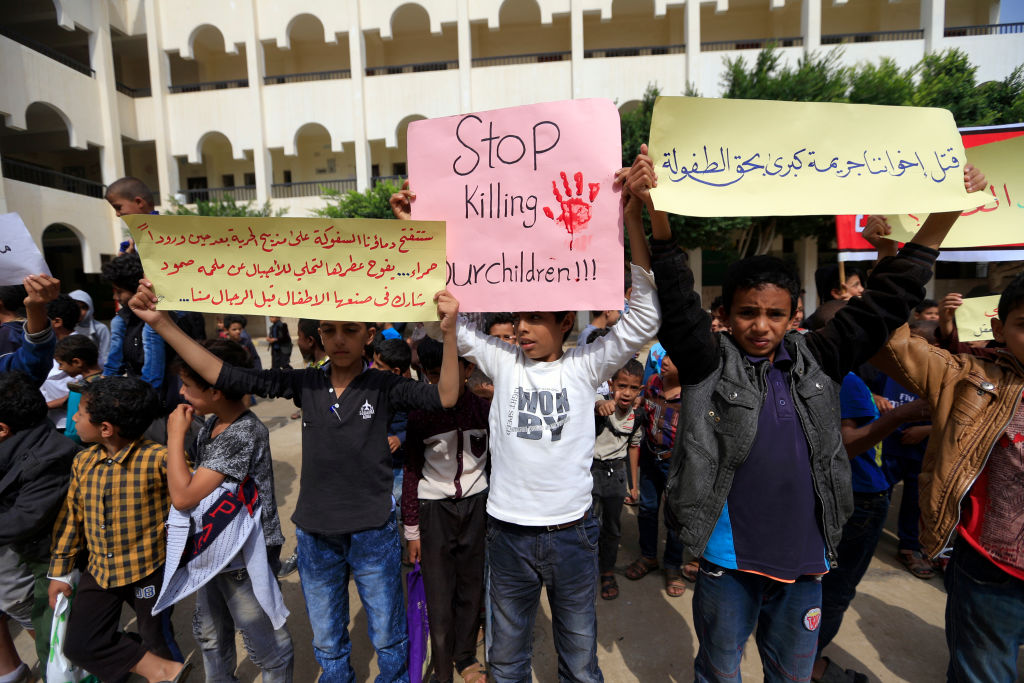 Yemeni children raise protest signs and chant slogans during a demonstration in the capital Sanaa on August 12, 2018, against an air strike by the Saudi-led coalition which hit a bus killing dozens of children in the northern Huthi stronghold of Saada. (MOHAMMED HUWAIS/AFP/Getty Images)
