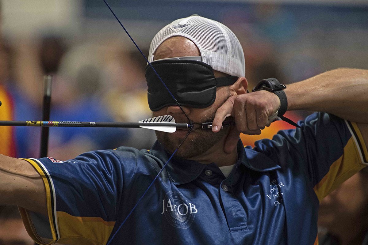 Coast Guard Maritime Enforcement Specialist 2nd Class Jacob Cox competes for Team Navy in archery at the 2019 Department of Defense Warrior Games on June 24 in Tampa, Fla. (Mass Communication Specialist 1st Class Tyrell K. Morris/Navy)