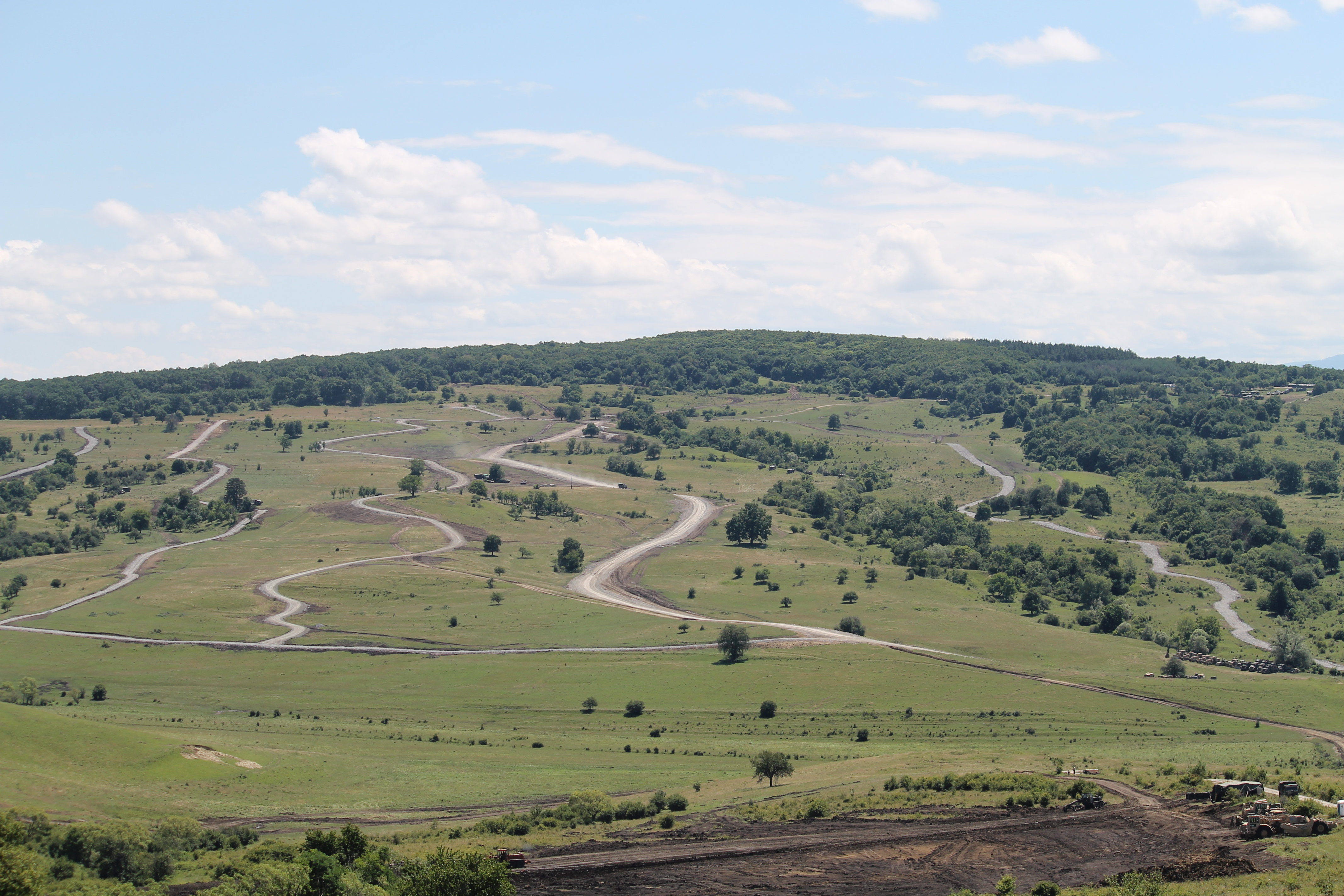 The nonstandard live fire range has five lanes for tanks, which meets both the NATO standard of requiring four lanes and the Romanian standard for five lanes, allowing flexibility for multinational training. The engineers are in the process of removing an enormous chunk of hill at the bottom of the range to accommodate the moving targets and will remove roughly 153 cubic yards of soil when finished. (Jen Judson/Staff)