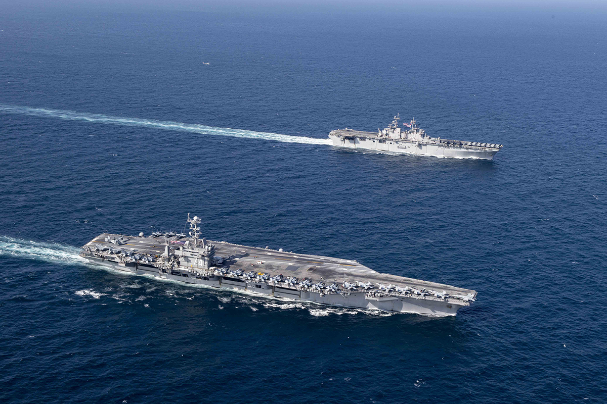 USS John C. Stennis (CVN 74) and the amphibious assault ship USS Essex (LHD 2) sail in formation on Dec. 14, 2018, in the Arabian Sea. (MC3 Connor D. Loessin/Navy)