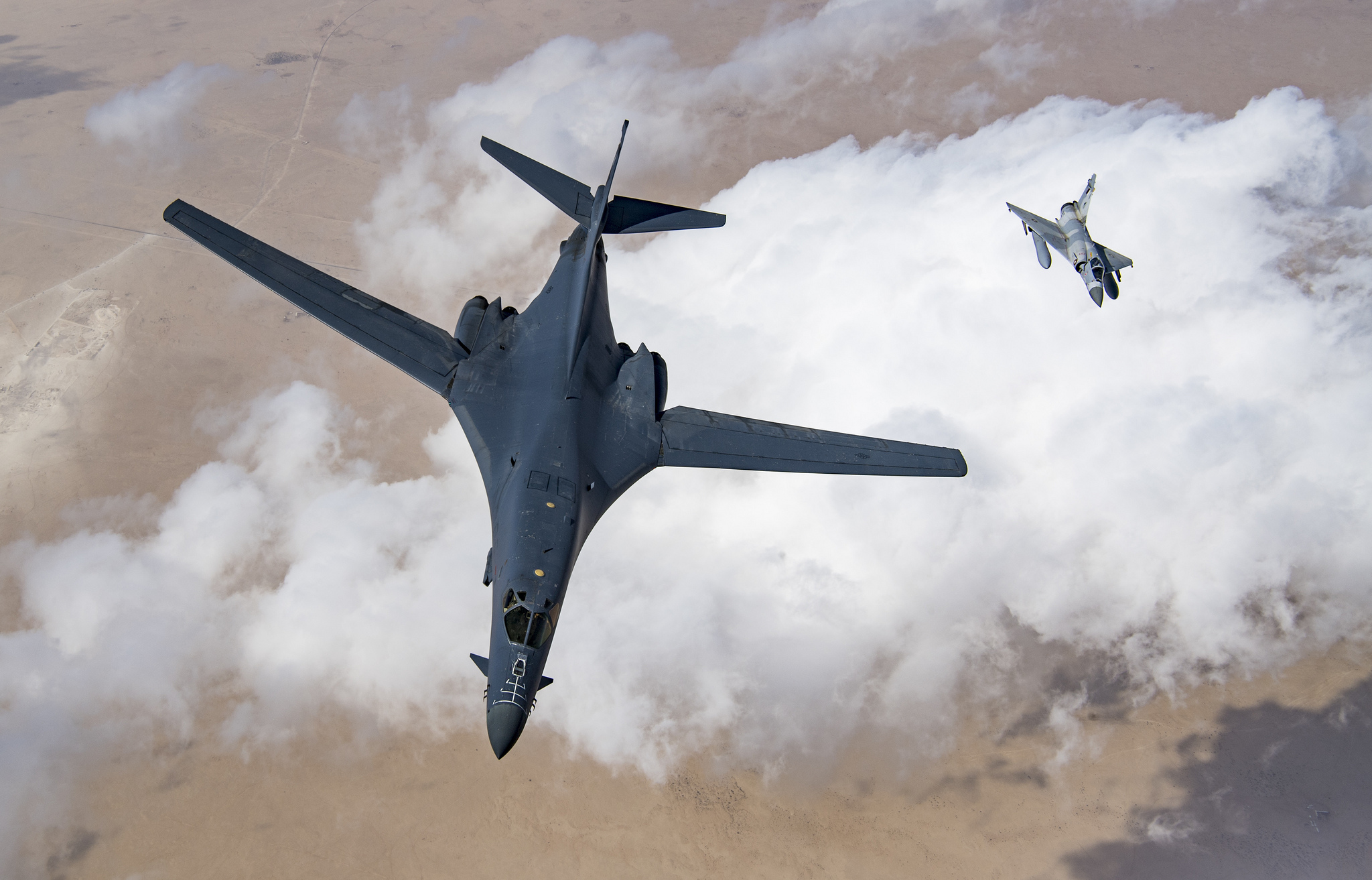 A U.S. Air Force B-1B Lancer bomber and a Qatari Mirage 2000 fly in formation, Feb. 19, 2019. (Staff Sgt. Clayton Cupit/Air Force)