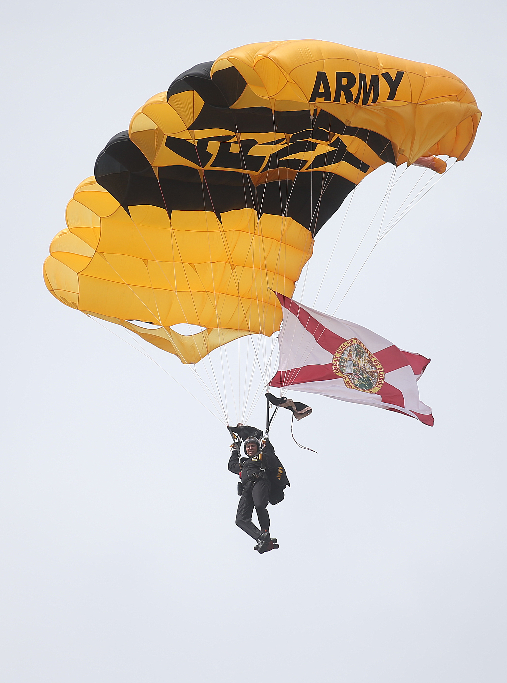 A member of the Golden Knights glides through the air during the Gulf Coast Salute Air Show at Tyndall Air Force Base in Panama City, Fla. (Patti Blake/News Herald via AP)
