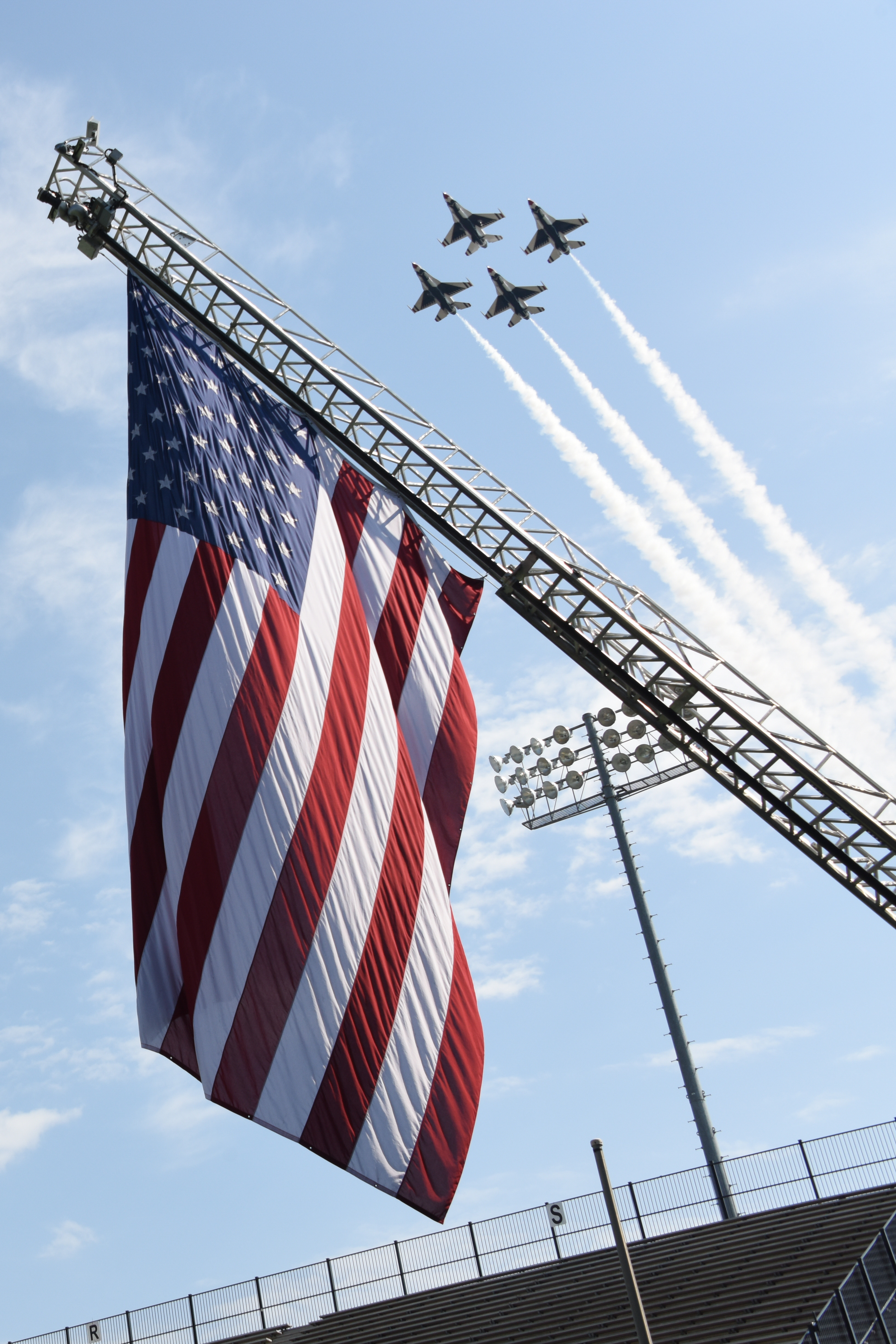 The U.S. Air Force Thunderbirds perform a fly-over of the Cramton Bowl stadium during the Officer Training School parade and graduation of