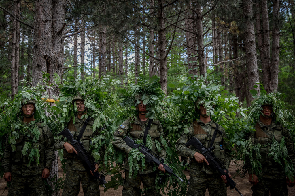 Kosovo Security Forces (KSF) new basic training recruits learn camouflage techniques while taking part in tactical exercises during the final weeks of their nine-week basic training on July 25, 2019 in Ferizaj, Kosovo. Created in 2008 the KSF was formed mainly to deal in crisis response, civil defense and the removal of ordnance left from the 1990Õs conflicts, however in December 2018 the Assembly of Kosovo passed legislation to redefine the KSF as a professional military force. (Photo by Chris McGrath/Getty Images)