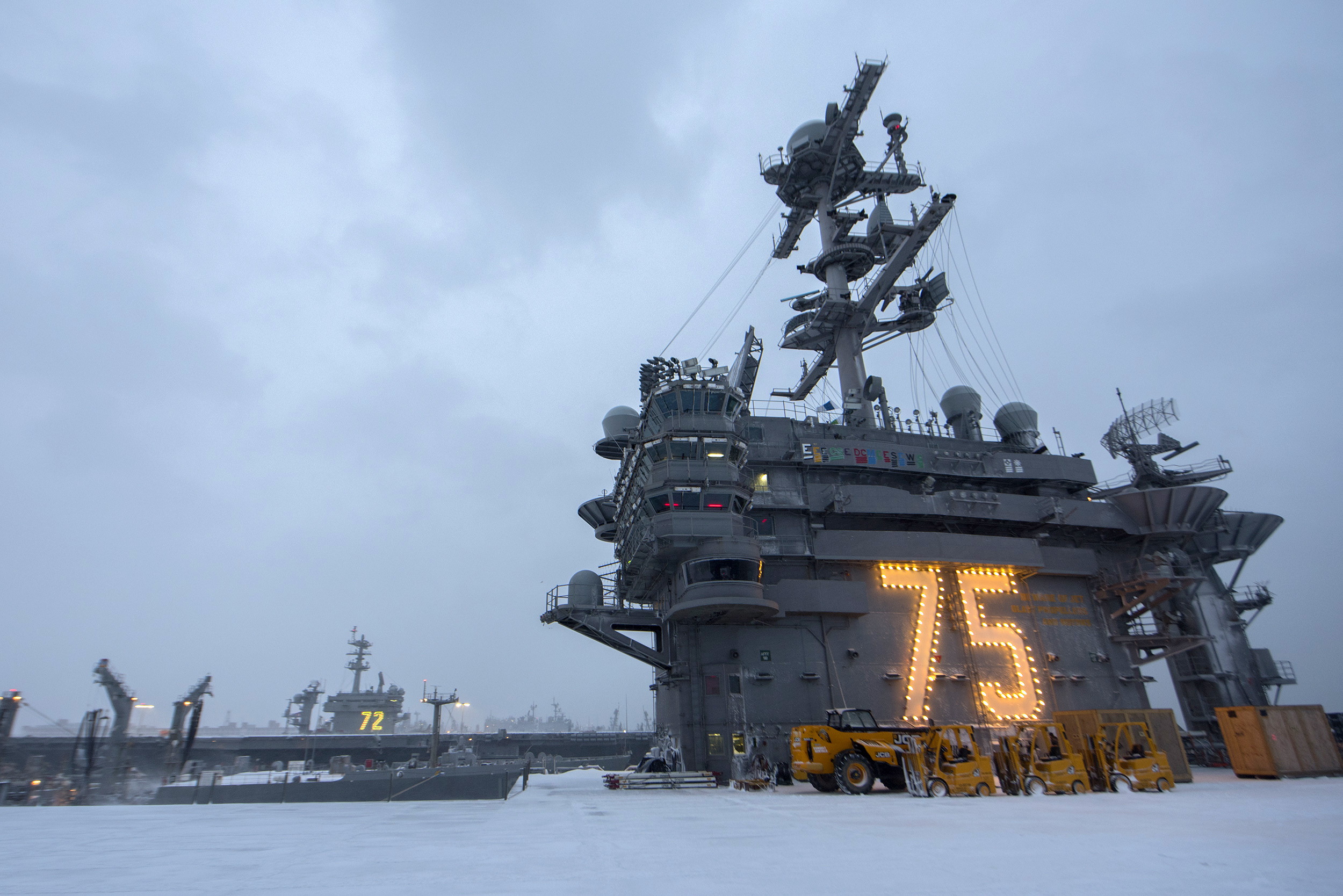 The aircraft carriers USS Harry S. Truman and USS Abraham Lincoln are blanketed with snow following blizzard-like conditions. (Scott Swofford/Navy)