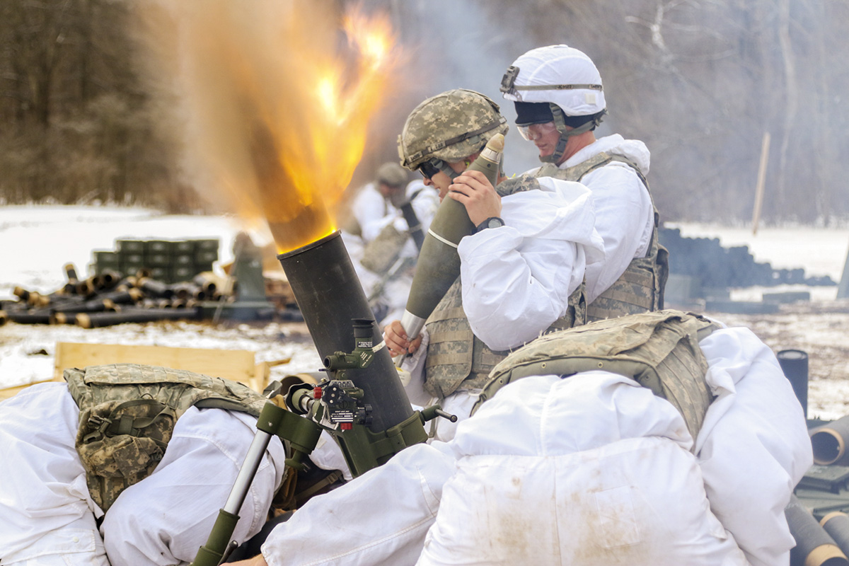 Soldiers from 3rd Squadron, 71st Cavalry Regiment, 1st Brigade Combat Team, 10th Mountain Division (LI), fire rounds down-range using a M120 120mm mortar, into the impact zone during a mortar live-fire exercise here on Fort Drum, March 7, 2018. (Staff Sgt. James Avery/Army)