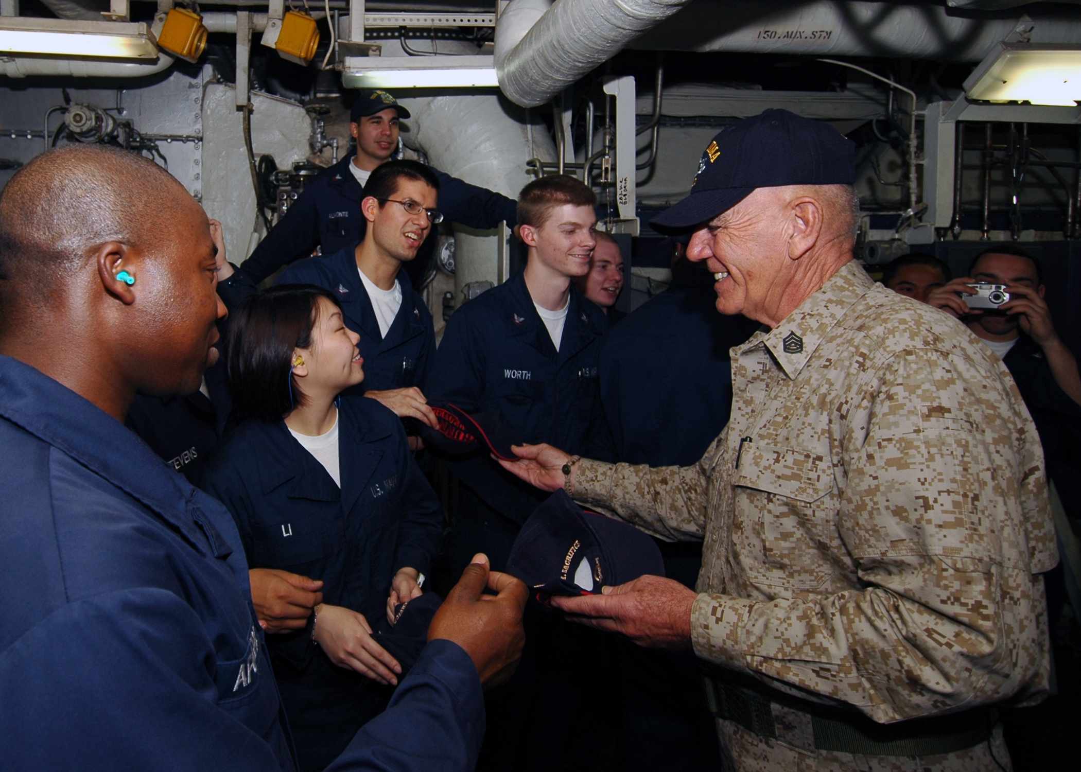 Retired Gunnery Sgt. R. Lee Ermey visits with Sailors and Marines aboard the multi-purpose amphibious assault ship USS Iwo Jima. Iwo Jima is deployed as part of the Iwo Jima Expeditionary Strike Group supporting maritime security operations in the U.S. 5th Fleet area of responsibility. (MCSN Chad R. Erdmann/Navy)