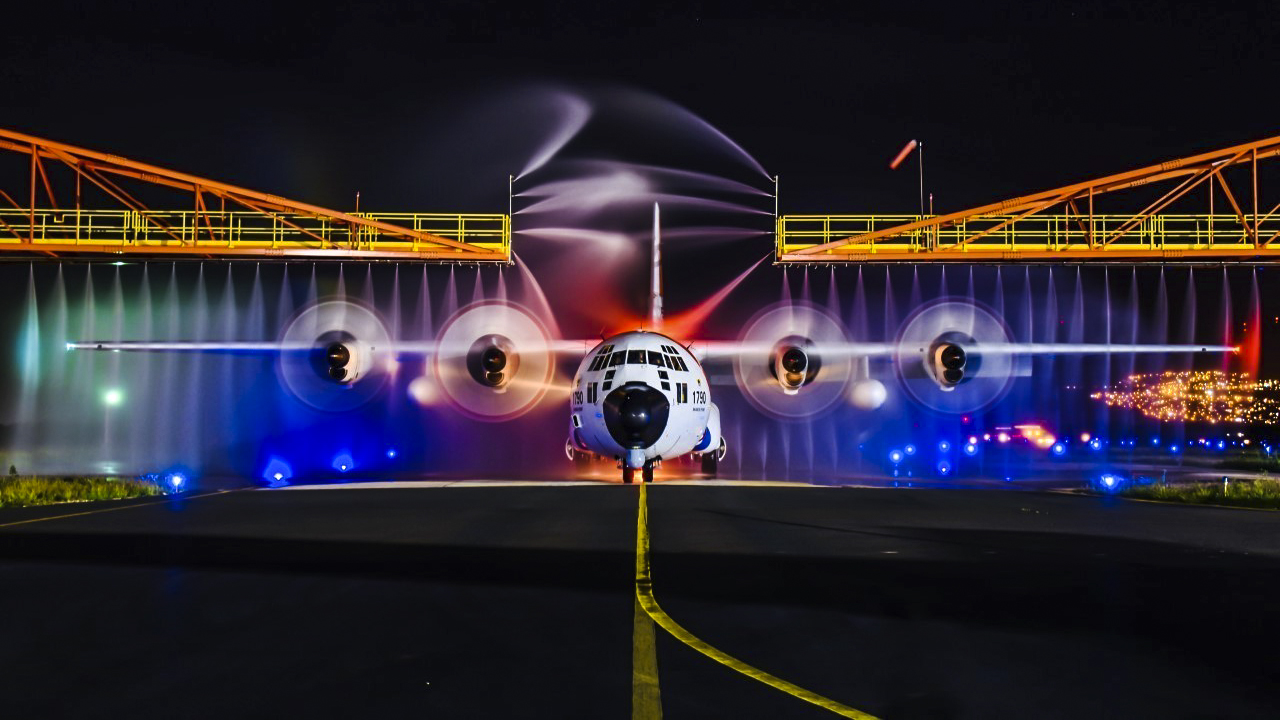 A Coast Guard HC-130 Hercules airplane gets rinsed down at Air Station Barbers Point, Jan. 24, 2018. Crewmembers maintain operational readiness by washing the plane after every flight to protect it and remove any salt. (Chief Petty Officer Brandon Kelly/Coast Guard)