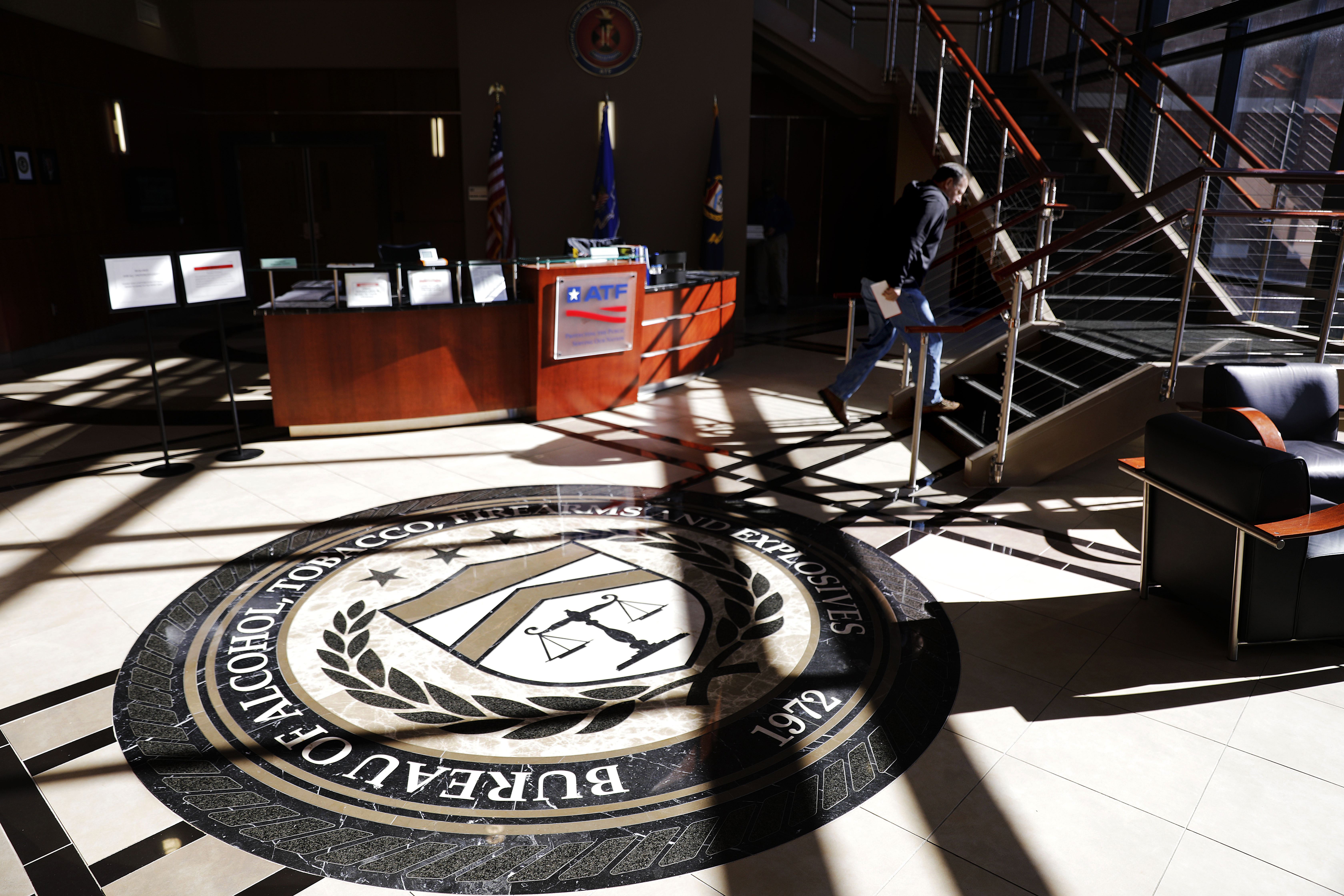 A worker walks through the empty lobby of the federal Bureau of Alcohol, Tobacco, Firearms and Explosives' National Center for Explosives Training and Research in Huntsville, Ala., Wednesday, Jan. 9, 2019. About 70 federal agencies are located at the Army's sprawling Redstone Arsenal, and more than half the area economy is tied to Washington spending. (David Goldman/AP)
