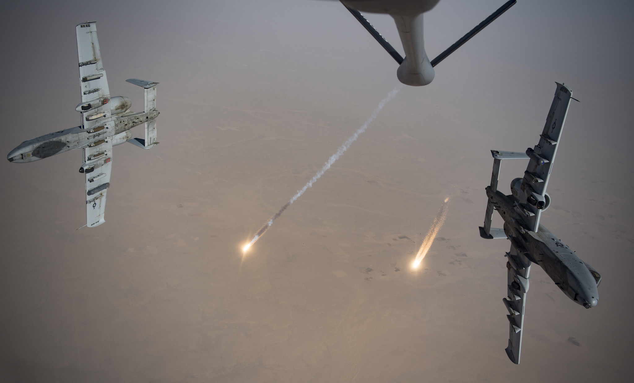 U.S. Air Force A-10 Thunderbolt IIs fire flares while breaking away after aerial refueling from a KC-135 Stratotanker out of Kandahar Airfield, Afghanistan, Aug. 15, 2019. (Staff Sgt. Keifer Bowes/Air Force)