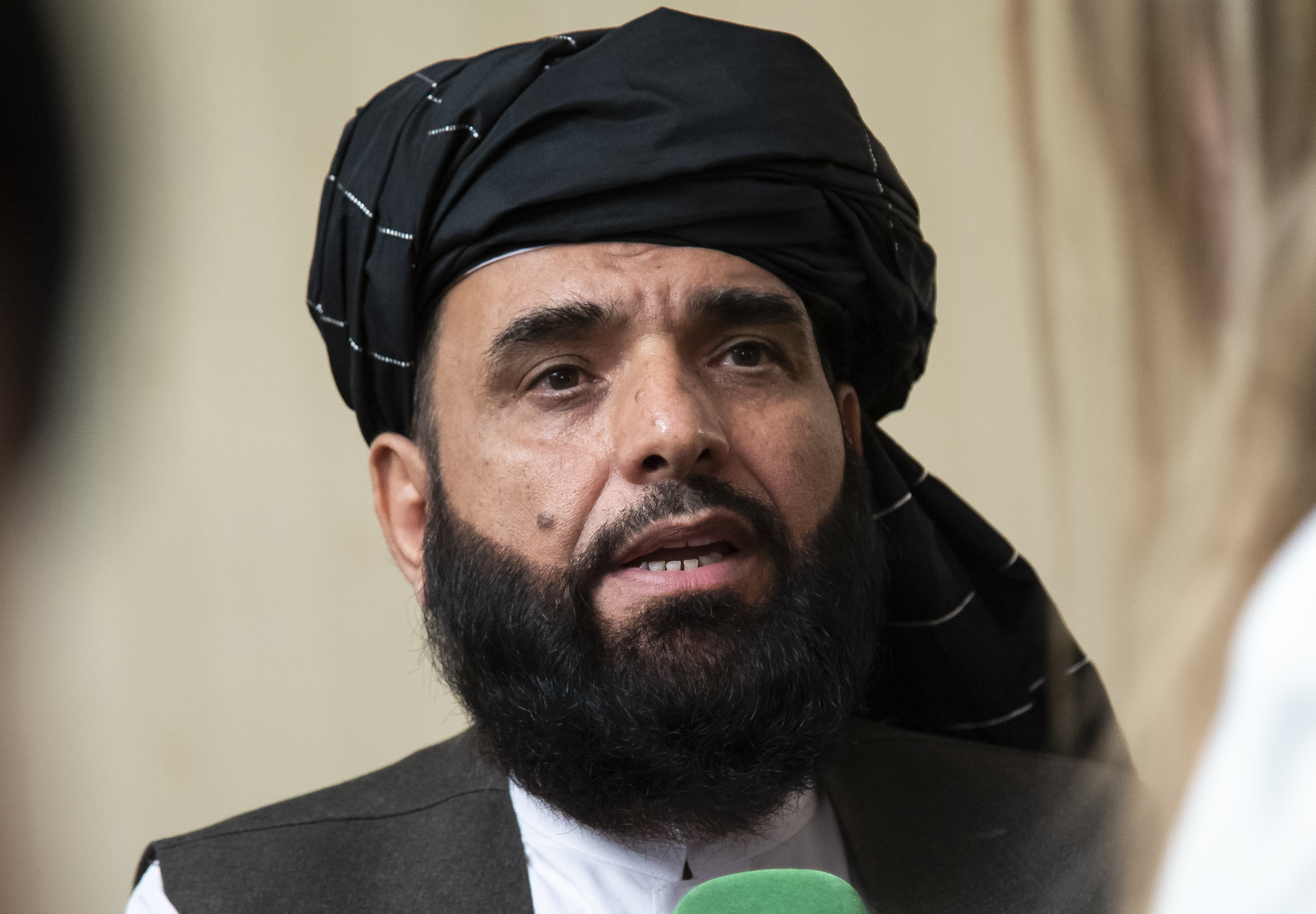 In this May 28, 2019, file photo, Suhail Shaheen, spokesman for the Taliban's political office in Doha, speaks to the media in Moscow. (Alexander Zemlianichenko/AP)