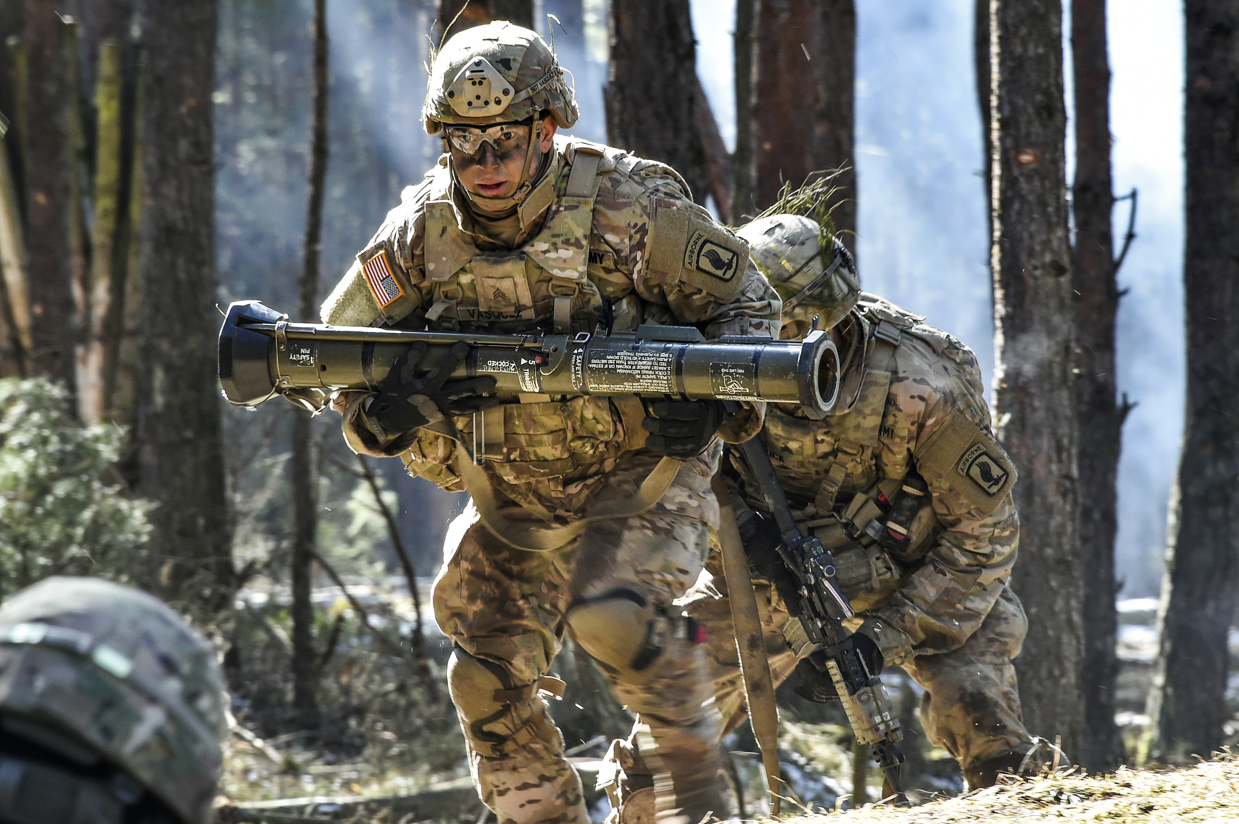 A U.S. Army Paratrooper with 2nd Battalion, 503rd Infantry Regiment, 173rd Airborne Brigade carries a AT-4 training grenade launcher during a platoon level live fire exercise at the 7th Army Training CommandÕs Grafenwoehr Training Area, Germany, March 21, 2018. (Gertrud Zach/Army)