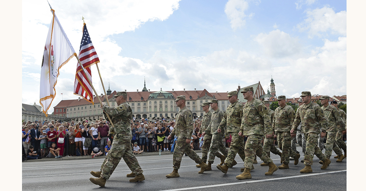 A group of US Army soldiers take part in a yearly military parade celebrating the Polish Army Day in Warsaw, Poland, Wednesday, Aug. 15, 2018. Poland marks Army Day with a parade and a call for US permanent military base in Poland. (AP Photo/Alik Keplicz)