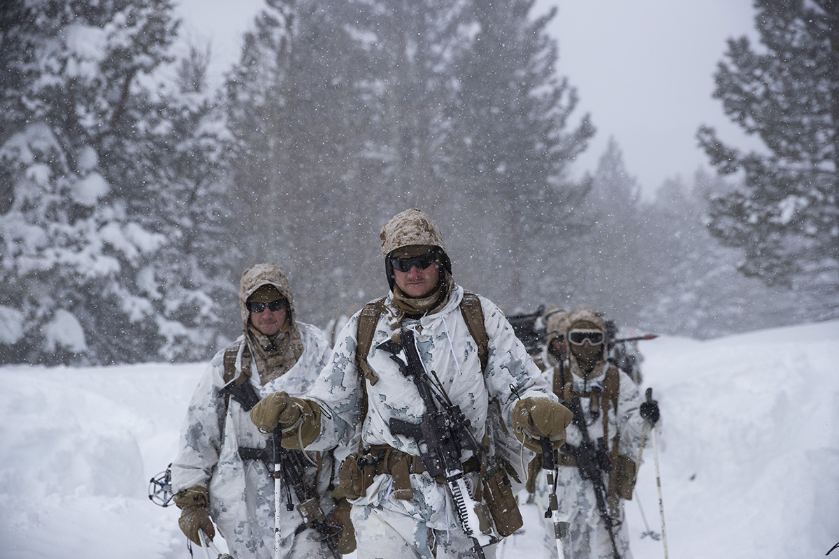 U.S. Marines walk along a snow-covered trail during their advanced cold-weather training at the Marine Corps Mountain Warfare Training Center Sunday, Feb. 10, 2019, in Bridgeport, Calif. After 17 years of war against Taliban and al-Qaida-linked insurgents, the military is shifting its focus to better prepare for great-power competition with Russia and China, and against unpredictable foes such as North Korea and Iran. (Jae C. Hong/AP)